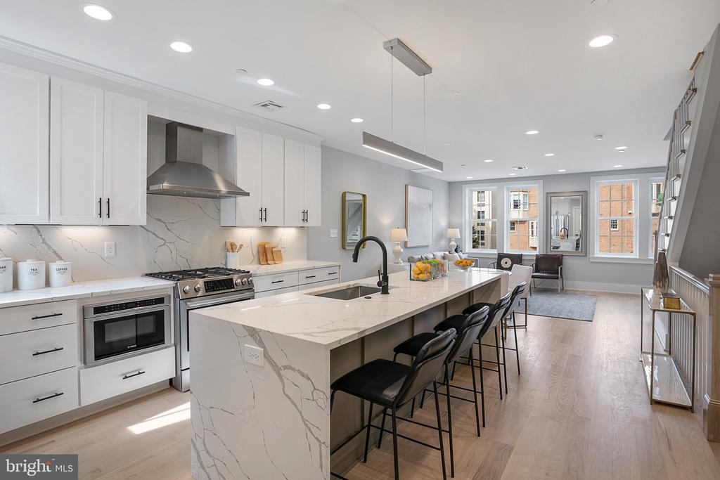 Sophistication, style, and elegance converge in this rare opportunity to own one of three newly constructed exemplary homes.  Ideally positioned on the trophy stretch of O Street in the heart of Dupont, this stunning brick federal contemporary masterpiece is designed to impress even the most discerning of homebuyers. Welcome to the Fiona Condominiums, offering 3 new expansive condos thoughtfully designed with impeccable finishes and treatments at every angle. Each residence is outfitted with a high-end suite of finishes including stunning kitchens with Calacatta Laza quartz countertops and top tier Bosch appliances, Italian imported Edimax Astor velvet tile bathrooms, and finished in place oak flooring.  Penthouse 3 offers over 1800 square feet of stylish living space with 3 bedrooms, and 2 and a half beautifully appointed bathrooms, spacious den with wet bar with a 38-bottle dual-zone cooler that leads to a picture-perfect rooftop terrace ideal for sophisticated entertaining. 1 separately deeded parking space to convey.  Look beyond the finishes and discover countless details that separate this condominium from anything on the market: in-wall sound isolation between rooms and floors, historic grade double glazed windows and doors, and Trex select composite decking with RainEscape drainage system. An unbeatable location, a near-perfect walk score.
