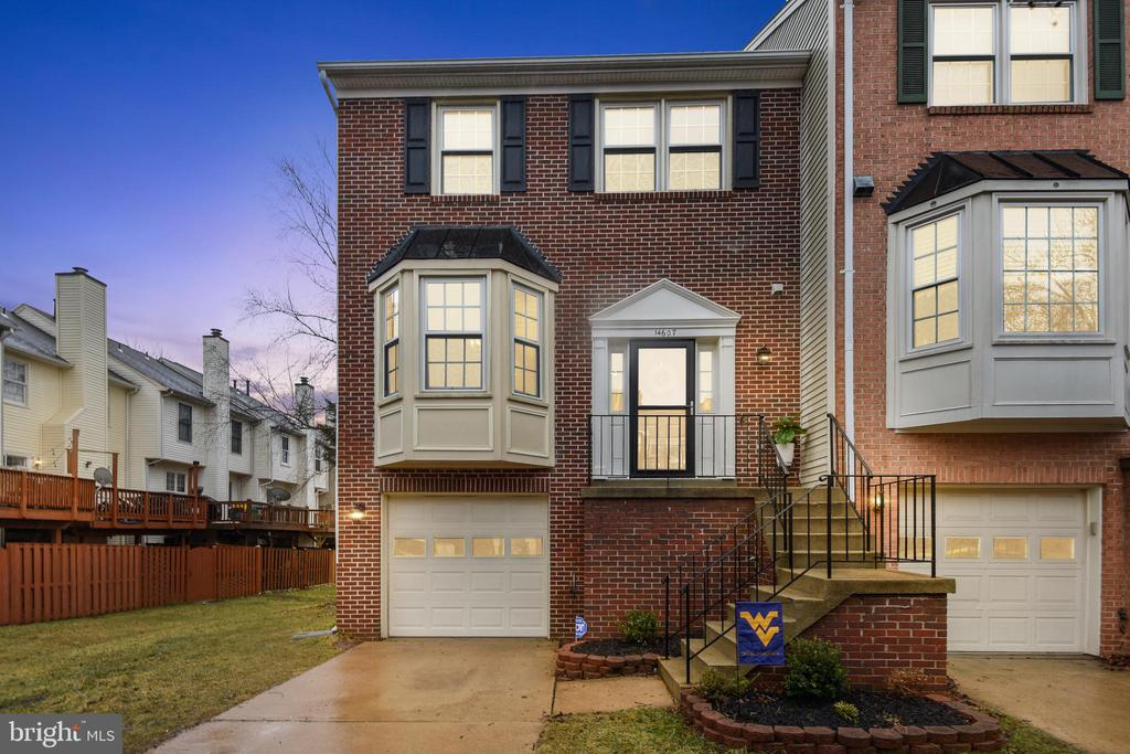 WELCOME HOME!!! Meticulously Maintained**Spacious & Sunny Brick Front END UNIT Townhome with GARAGE**Kitchen Updated with New Appliances, Flooring, Countertops & Light Fixtures**Eat-In Kitchen and Separate Dining Area**Lovely Hardwood Flooring on Main Level**Living Room Walks out onto New Deck**3 Large Bedrooms and 2 Full/2 Half Baths**Fresh Paint Throughout & New Carpet on Upper and Lower Levels**Washer/Dryer 2019, Front Doors Replaced in 2017, HVAC & Windows  Replaced in 2013 - Windows Come with a 40 Year Warranty!!Lower Level Family Room has a Wood Burning Fireplace that leads out onto a New Patio -Fenced & Gated**STORAGE SPACE GALORE!!  Over $40K in Improvements** Long Driveway for Multiple Vehicles and 2 Visitor Parking Passes!! Enjoy Sully Station Community Amenities (Club House, Pool, Party Room, Tennis & Tot Lots)**Convenient Location to Shops, Restaurants, Dulles Airport, Rt 66 and More  OPEN SATURDAY  March 6th (1:00-3:00)
