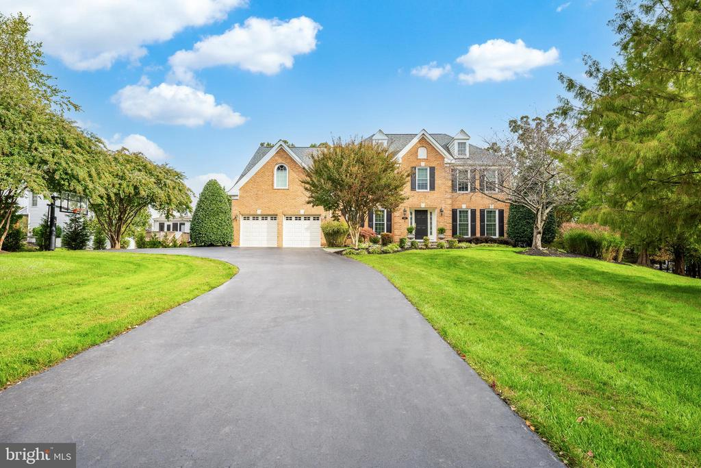 Large and luxurious updated home in North Potomac, move in ready, with high end finishes and upgrades for exceptional living. The open concept main floor boasts first class finishes including a double story foyer, crown molding, plantation shutters, and hardwood floors throughout. The sprawling gourmet kitchen features an oversized island with seating, high-end stainless steel appliances such as Viking, Miele and Sub-zero, ample cabinetry, elegant butler's pantry and large breakfast area make this an absolutely perfect space for everyday living and grand entertaining. The kitchen is open to the family room and the spacious deck, making this space ideal for entertaining. Rounding out the main level is a home office with built in shelving and cabinets, sun room, formal dining room,  sitting room, 2020 updated powder room, mudroom with laundry and convenient access to the two car garage complete with cabinetry for ample storage.    The sprawling primary suite with high ceilings and natural light coming through the large windows, offers an illuminating and airy feel. The large ensuite bathroom was recently upgraded and  features dual vanity sinks, custom cabinetry, a spa-like shower, soaking tub, water closet, heated floor and heated towel rack and two custom-fitted, huge his and hers walk-in closets.  Additionally, there are three spacious bedrooms (two with built- ins throughout) and two full bathrooms which complete this level.   Downstairs, the fully finished walk-out basement includes a gym, storage room, and a substantial recreational space big enough for a pool table and multiple seating areas. Enjoy direct access to the large tree-lined backyard. Outside is a deck and gazebo spanning the entire length of the house and the yard has an underground sprinkler system to keep the over ½ acre property and gardens and plantings in great shape. The roof was replaced within the last 10 years.