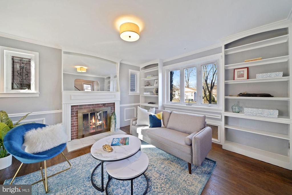 OPEN SUNDAY 3/7, 1-3PM! ALL OFFERS DUE MONDAY 3/8 BY 4PM! This 1940's classic three-level, all-brick, detached Colonial could be all yours! It offers three bedrooms, two baths and off-street parking for two cars (and more), and features gleaming hardwood floors, renovated kitchen and baths and an expansive rear garden. Perched on a slight hill, this charming home has wonderful curb appeal and once inside, affords a gracious flow throughout the main level's living spaces. The sun-filled living room, with two exposures is anchored by a brick fireplace accented in brass and opens to the formal dining room, both of which feature built-ins and attractive architectural details! From there, the renovated kitchen with peninsula island is equipped with quartz countertops, stainless steel appliances, an abundance of storage, and direct access to the rear deck and yard. Located on the upper level is the primary bedroom, two additional bedrooms and a renovated full bath with direct access to the primary bedroom. The spacious lower level is a blank canvas and awaits your vision! It has an updated full bath, a pet bathing basin, and provides direct access to the parking area and rear yard, which is lined with mature trees. Truly a special offering!