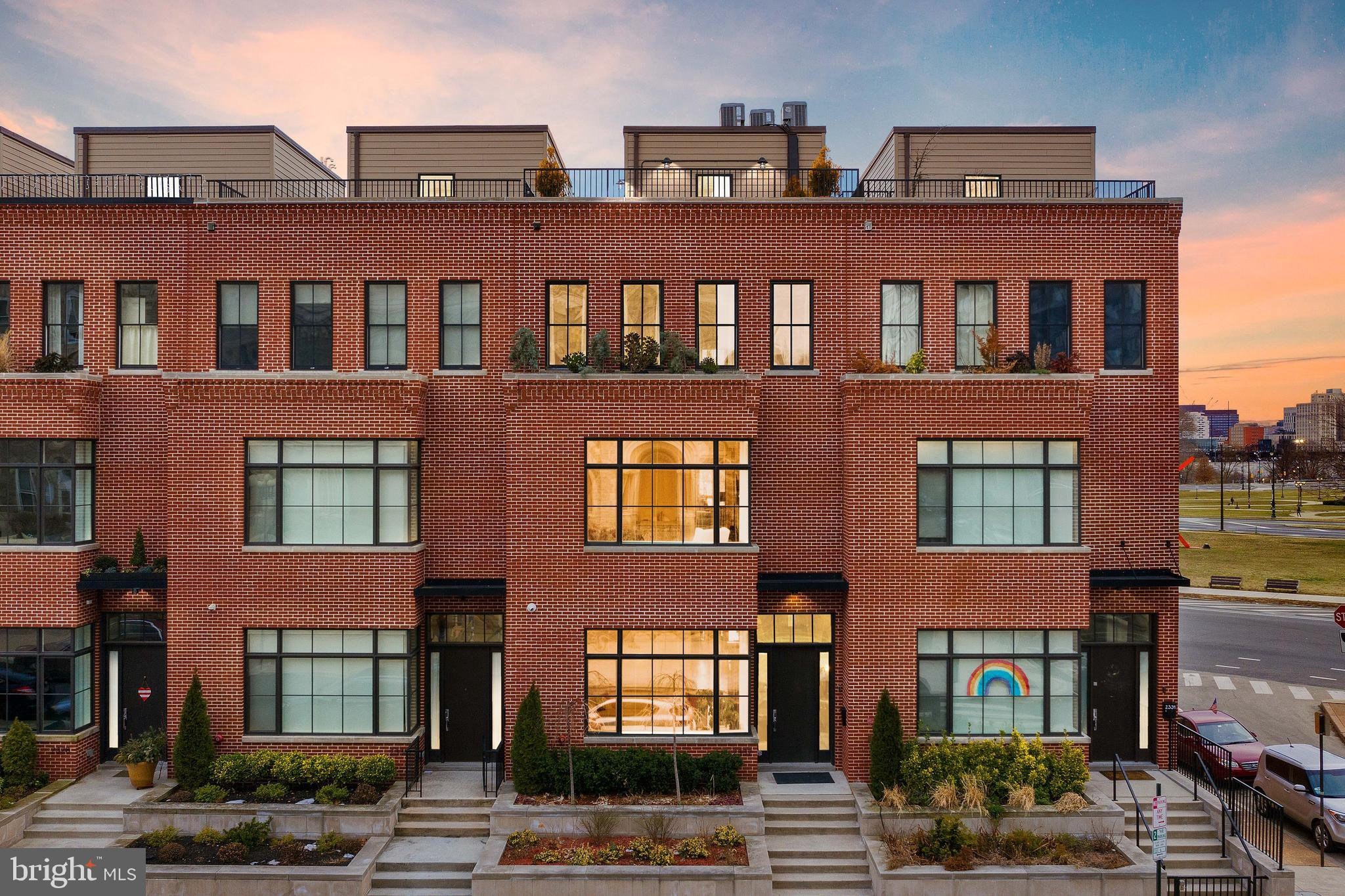 Welcome to one of the most desirable townhouses in all of Fairmount designed by Canno architecture and design group. Enter this 22-foot-wide home with over 4,400 square feet and you are immediately greeted with an inviting living area with a gas-burning fireplace and over 12-foot ceilings. The kitchen, built for a chef features white quartzite countertops, a Thermador 6-burner stovetop, a matching double wall oven, warming drawer, and a separate custom-built pantry for additional storage. The dining area is open to the kitchen, perfect for a large family gathering, and includes access to a south-facing outdoor balcony and wet bar. On the second floor, you will find 3 bedrooms, 3 bathrooms, and a large laundry room with a folding table and wall system. The third floor is home to the generously sized primary suite with a five-fixture bathroom and seating lounge. The top floor hosts a pilothouse with a full wet bar, powder room, and nearly 1,000 square foot Porcelain pavers roof deck with a pedestal system, water irrigation planters, a gas hook-up, outdoor lights, and electrical outlets. Each floor of the townhouse is interconnected with unobstructed views of Center City, the Barnes Foundation, and the Philadelphia Art Museum. The basement, currently shown as a family room or extra den is versatile and can be used as a gym, home office. Additional features of the home include an elevator, 2 car parking, an eight zone Sonos system, a savant smart system that controls the lights, security cameras, and garage door, all automated shades could be added to the system.  Tax abatement starting January 24th, 2017. All furniture and customized pieces are available with a separate Bill of sale.