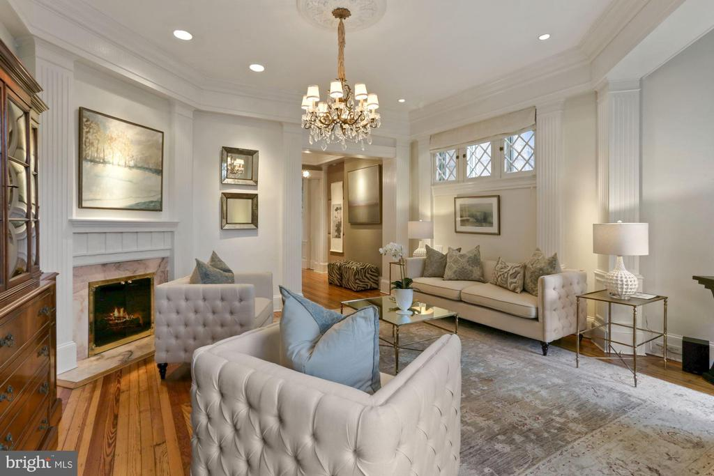 New Look- New Pics - New Price ! Stunning renovated, historic Kalorama row house on four finished levels with over 4,300 livable sq ft. Entrance level foyer with grand staircase leads up to the main level. Main level provides ample entertaining space with formal living room, formal dining room with chandelier, and gourmet eat-in kitchen featuring granite countertops, stainless appliances etc . The fenced rear garden is accessed through the kitchen. Upper level with owners suite including expansive bathroom with separate tub and shower, fireplace and sitting area. Top floor with two additional bedrooms, bathrooms and spectacular roof deck with panoramic views of Washington. Stunning features to include 5 fireplaces, hardwood flooring, original millwork details on stairwells, recessed lighting, and off-street parking for one car.