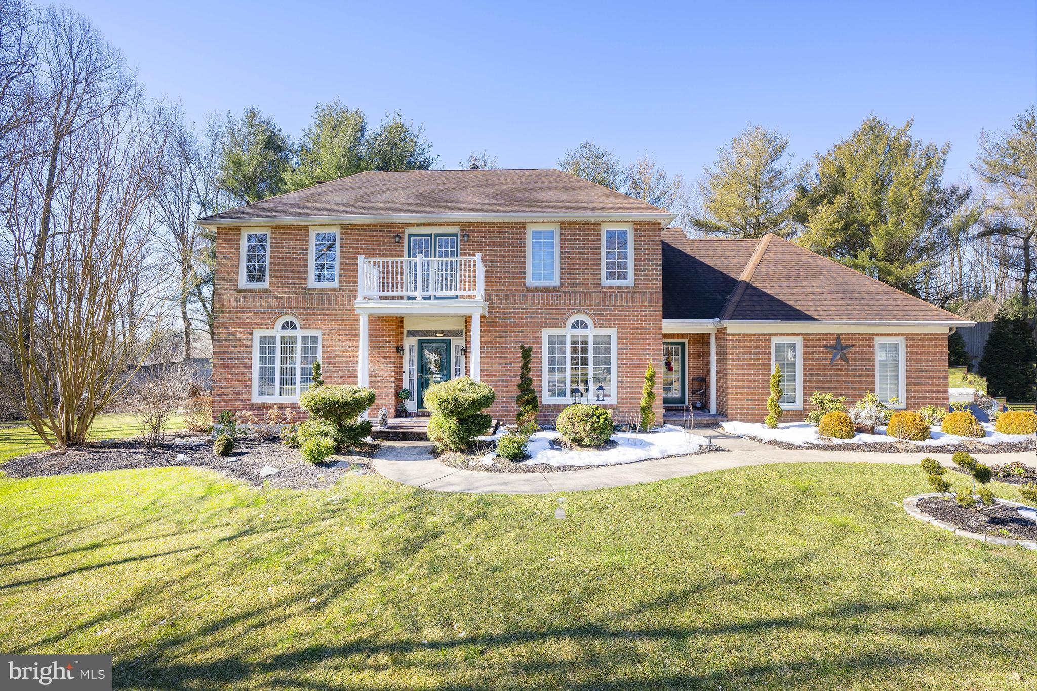 Welcome to this fabulous Hockessin colonial in desirable Westover Chase. This stylish and well-maintained home is nestled on private cul-de-sac and offers a flowing open floor plan. A winding walkway welcomes you to the grand entrance foyer with a stunning oak staircase flanked by a sophisticated formal living & dining rooms that are accented by triple circle top windows providing an abundance of natural light to the space. The elegant living room features French doors that transition to a casual vaulted family room with a stone fireplace & skylights. Enjoy family meals in the adjacent gourmet kitchen complemented by newer stainless steel appliances, granite counter tops, mosaic back splash and large center island. The breakfast room with sliding doors provides access to an impressive sunny 3-season room with luxury laminate flooring, new windows and wet bar. Sliding doors usher you to a custom paver patio with fireplace that is perfect for outdoor gatherings while enjoying the level yard. A functional laundry/mud room with entrances to the front & back exterior, updated powder room and 3-car garage completes this floor. The second level features a hall bath with tile surround and new vanity. The additional bedrooms are generous in size offering ceiling fans with an abundance of closet space. Retreat to the Master bedroom & enjoy two walk in closets with double door access to the sitting room featuring an exterior balcony.  Relax in this breathtaking brand new primary bath with neutral custom tile work, new granite topped vanities and spa shower with upgraded 8 zone shower head. Completing this package is a fantastic finished lower level with new full bath. This space is perfect for an exercise, theater room and also offers a large storage area. A maintenance free vinyl exterior and loads of curb appeal completes this package. All of this, plus located close to schools, shopping, county parks, Hockessin Athletic Club and major roads. Don't miss this opportunity to m