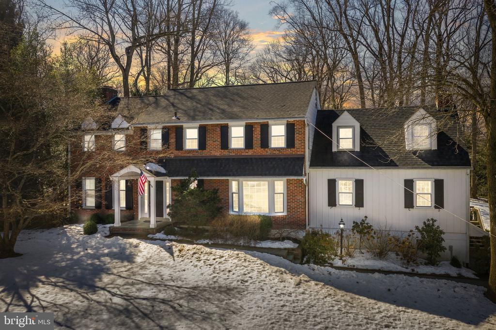 A beautiful home in Gladwyne - this stately brick colonial offers updated and gracious living spaces on a beautifully landscaped acre lot. The Front Flagstone walkway leads to a beautiful wood door, center hall with access to office, living room, dining room, half bath, front stairs, kitchen, family room, back stairs and access to the basement. Every room shows the attention to detail with beautiful hardwood floors, chair rail, crown molding, two wood burning fireplaces (LR & Family room off kitchen) new windows (Marvin custom wood) and doors and deep windowsills throughout. The updated and expanded kitchen has stainless steel appliances, with Wolf 6 burner range, Double ovens, Warming drawer, two sinks, Built in speakers, White macubus granite/quartzite counters, beautiful white wood cabinetry, soffit and accent lighting, Sharp drawer microwave oven and French sliding doors to the back flagstone patio and yard. The laundry room is off the kitchen with tile floor, gas dryer, white wood cabinetry for storage, quartz counter tops and a useful frosted privacy door. There is a side door to the back/side deck for quick access to the back yard and driveway. The Family Room has a wood burning fireplace, sliding doors to the deck, surround sound and a wet bar complete with beverage refrigerator, granite countertop, hammered copper sink, and copper fixtures. The separate office, in addition to the beautiful new bay window and built-in shelving, could not be more convenient & allows for the flexibility needed in the current work/professional environment.  The Living room has the second wood burning fireplace, built in shelving and wood cabinetry and flows into the large Dining Room that has the third set of French doors that lead to the back slate patio and yard. The extensive upgrades and kitchen addition create a home with gracious and sophisticated living and entertaining spaces. The second-floor features 5 bedrooms and 3 full baths. Master bedroom with Spacious walk-in cl