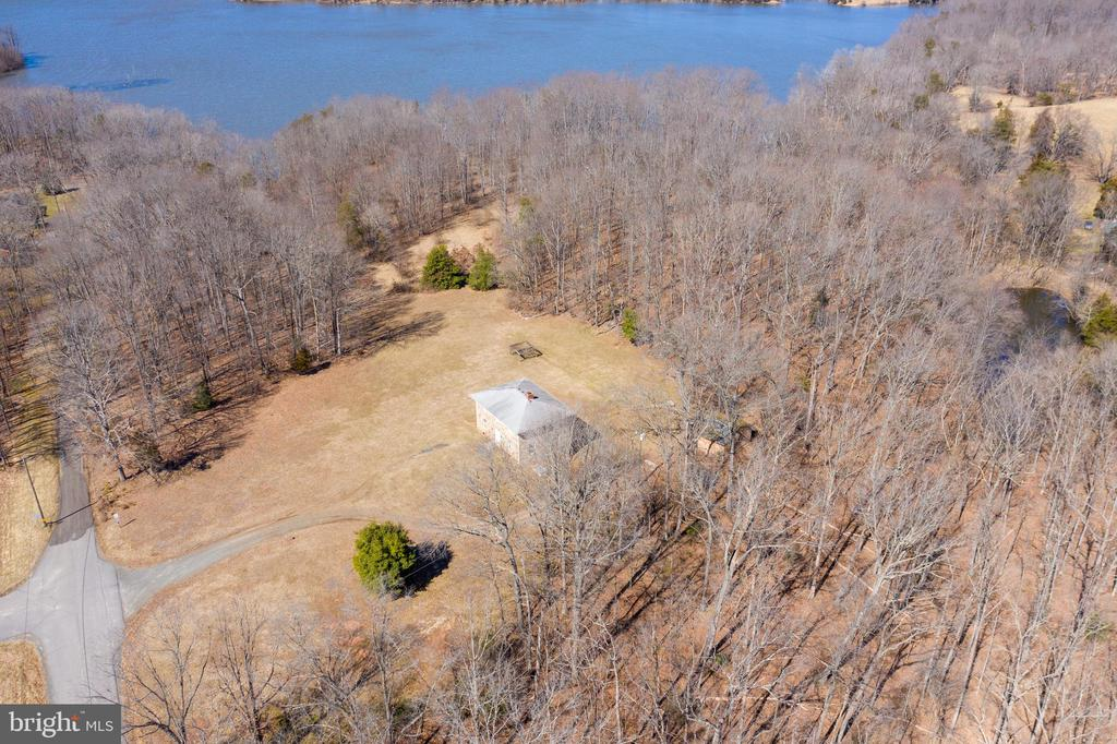 Over 17 acres on Lake Manassas! Zoned A1 this property is truly amazing.  3 story stone house needs to be finished with your own personal touch. 2 car garage on property.  There is also a pond.  This property has a ton of potential so don't miss out on not seeing it! Schedule your showing today!