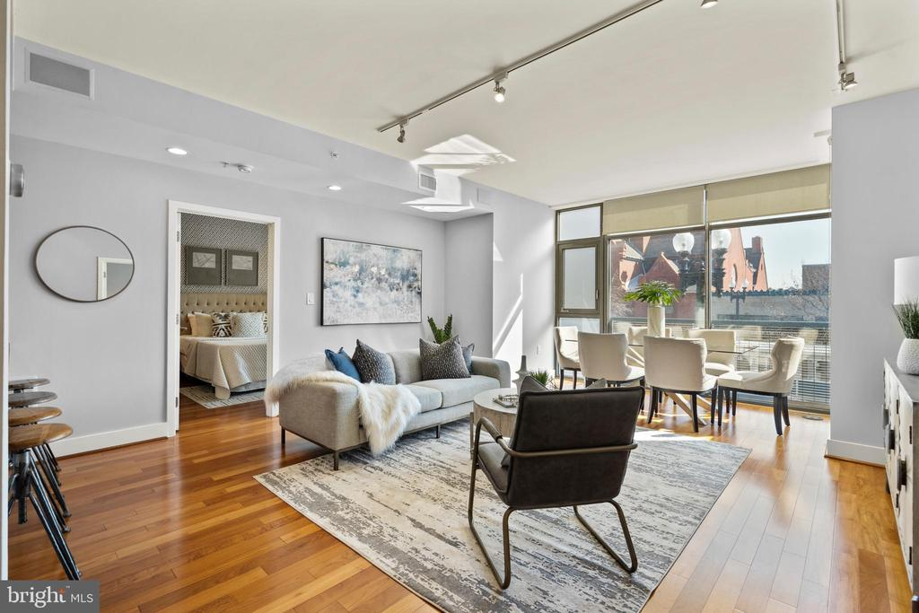 """PRICE IMPROVED!!! OPEN HOUSE ON SUNDAY 4/18 FROM 1-4 PM. Enter """"0202"""" at call box at front of building to be let in.  Gorgeous 2BR/2.5BA condominium in sought after and secure building in vibrant Logan Circle. The Q14 condominium is located at 14th & Q Street, right across from Le Diplomate. The unit is in pristine and move-in ready condition. View 3D Matterport Video in addition to several still pictures of the unit and community.    Features include: floor-to-ceiling windows with views of 14th Street; gourmet kitchen with stainless steel Bosch appliances (dishwasher and microwave); Subzero refrigerator; Jenn-Air gas range; Porcelanosa cabinets; expansive and open great room; and hardwood floors throughout the unit. Bosch dishwasher replaced in 2016. LG Washer and Dryer included in unit, replaced Jan. 2016.  Amenities include a rooftop terrace with panoramic views of the City, front lobby with seating area, party room, outdoor grill area, storage unit (rentable: prepaid through 2021). One underground parking space (space #12) conveys. The building is 0.7 miles and a 5+ minute walk from Dupont Circle Metro. Whole Foods is 2 blocks away; Trader Joe's is 5 blocks away; Barcelona Wine Bar, Estadio, Ted's Bulletin, coffee and dessert bars within a five-block radius. All the best of Logan Circle at your fingertips!"""