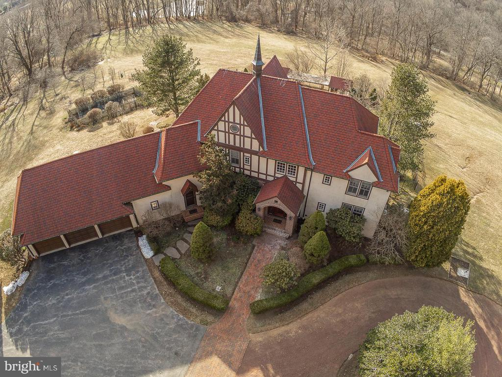 """Welcome to """"Belmeade"""".  This Peter Batchelor custom built Country Manor Home with approx. 6,000 square feet of living space is located at the end of a very special cul de sac street with a long history!  This 6 Bedroom, 5.5 Bath stately Home on the most private 15.2 acres awaits your visit.  As you head up the long winding driveway to this Home it fills you with a sense of peace with gorgeous views from every angle.  Enter the Foyer and feel right at home.  On one side of the foyer you will find a Bedroom with en-suite Bath and on the other is the Dining Room with hardwood flooring.  Hardwoods flow into the Great Room with an abundance of windows to show off the spectacular views.  The spacious Library has built-in bookshelves and is a great place to work from home!  The spacious and bright Eat in Kitchen with Breakfast Room has brand new hardwood flooring, 2 tier island, professional grade double stove/oven, 2 sinks, insta-hot water and a gas fireplace.  Completing the Main Floor is the Powder Room, Laundry Room with dog wash area and Mud Room with access to the 3+ car HEATED Garage!  Upstairs you will find the Main Bedroom with walk in closet and en-suite Bath, Princess Bedroom with en-suite Bath, 2 additional Bedrooms, full Hall Bath with jacuzzi tub, a Sitting Room PLUS another Bonus Room/6th Bedroom with access to the first attic area with electric and plumbing!   Another level up is the 2nd attic, great for storage!  The WALK OUT finished Lower level is simply amazing – with a huge Rec Room plumbed for a wet bar, large Gym with steam room, full Bath, wine room, large Pantry, utility room and exit out to the fenced in paver patio and inground Pool!  Move outside and find the most private and tranquil setting.  Sit on the Patio and relax, take a swim in the Pool, tend to the garden (fenced & trenched), pick fruit from your own Orchard (apples, pears and peaches), play horseshoes or just take in the scenery which is protected and can never be changed! A few more """