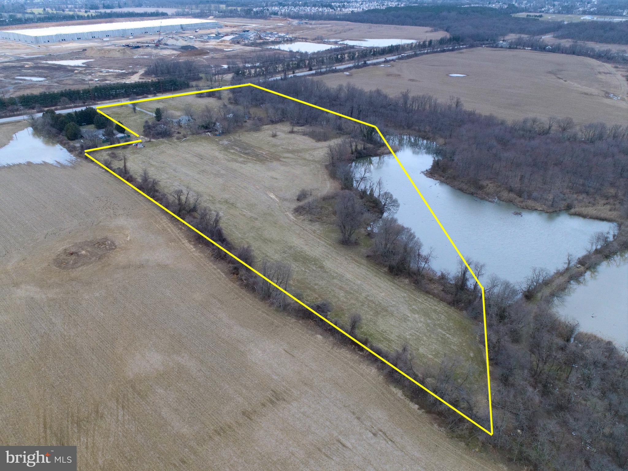 16.39 acre lot with house and garages. House and garages being sold as-is, where.  Buildings on property have no value. This district permits moderate to high density development and a full range of residential uses. Quoted $25,000 to tie into public sewer. Endless opportunities!