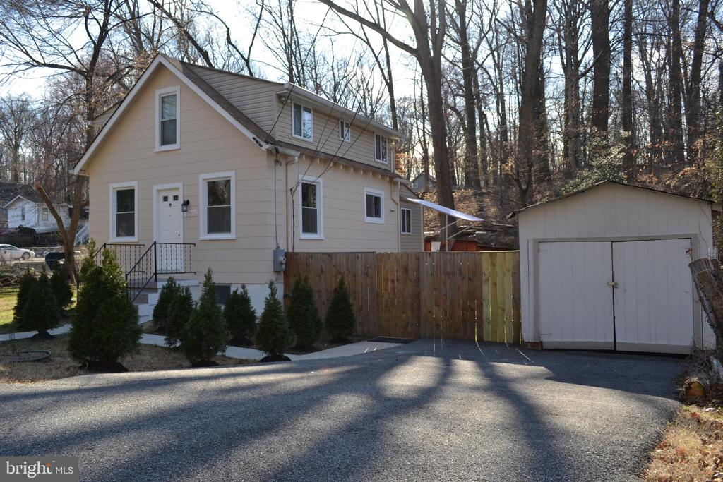 This lovely 3-level Colonial  in Suitland. is your private oasis(1.07 acres) just minutes of DC; Gorgeous kitchen with granite counters, recessed lighting,  appliances, kitchen cabinets including a gas stove! There are two bedrooms on the upper level with a full bathroom , one bedroom on the main level with a full bathroom. The basement is equiped with a suit-in-law with one additional room and a full bath, along with a spacious family room and wet bar and more... Out back you have a attached garage plus huge yard and walk way over creek! Plenty of room for your grill and patio furniture - and there's a spacious fenced yard -lots of room to play and grow! Also includes paved driveway .major commuter routes to Washington DC - yet wonderfully off the beaten path! You won't want to miss this one - You'll love living here!