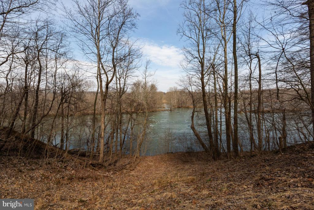 Positioned on one of the most serene locations on the Potomac River, Potomac Ridge captures over 260 feet of river frontage and sweeping views.   This extraordinary estate parcel is discretely positioned at the end of a private road with constantly changing views, natural wildlife, and exceptional privacy.  The estate affords numerous sites to build a custom home, all of which enjoy privacy and river views.  Nearby River Bend and Seneca Regional Parks are easily accessible via the adjoining Potomac Heritage Trail.  The prestigious village of Great Falls is just minutes away affording access to shopping dining, and a wide range of services for day-to-day living.  Tysons Corner is just 12 miles away, Dulles International Airport is 17 miles and downtown Washington is just 30 miles away.   Unquestionably, Potomac Ridge is one of finest remaining estate parcels along the highly coveted Potomac River. Copy and Paste for Virtual Tour: https://vimeo.com/521692243