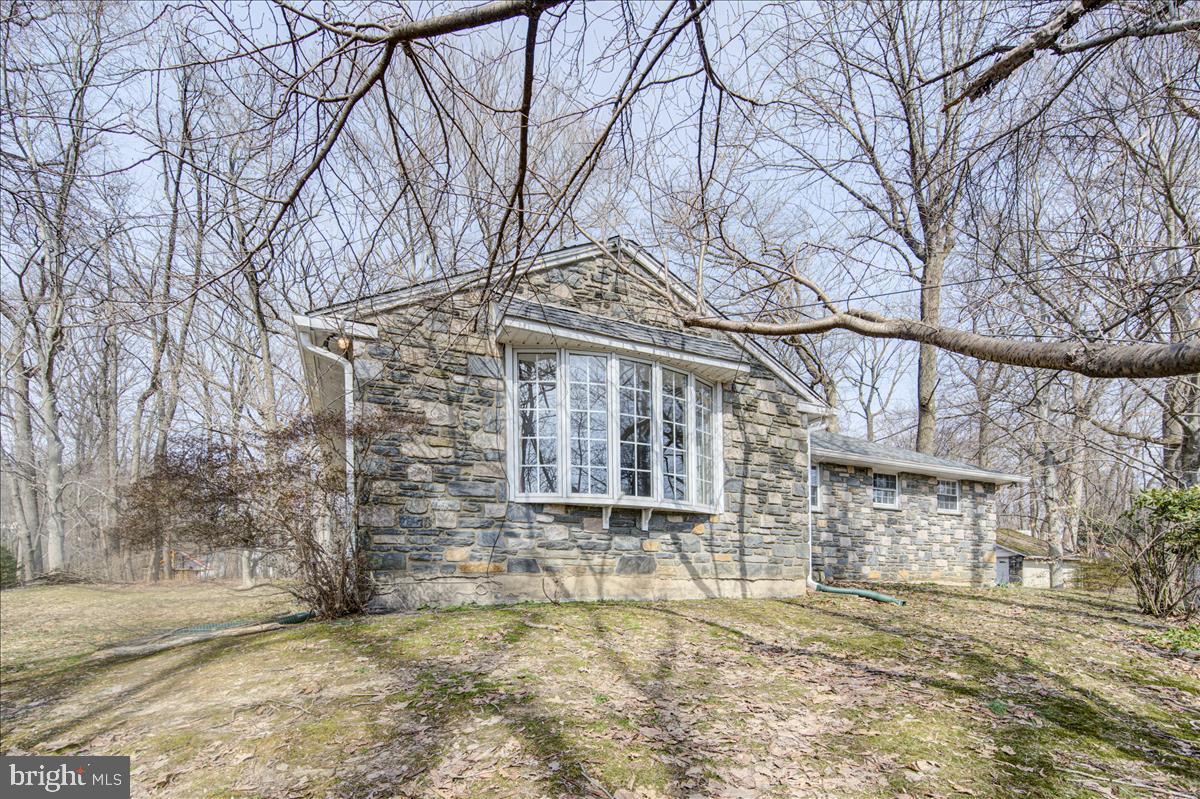 Welcome to this absolutely gorgeous Forest  getaway. If you are looking for a nice family home with ample space in the heart of Bryn Mawr look no further! This house was loved and taken care of by the owner for over 50 years. lets start with some details:  1960's Ranch Style with Curb Appeal on large 1.11 Acre lot, Surrounding Stone Exteriors, Natural Landscaping,Spectacular Hilltop View,Entry into Formal Living Room with Large Bay Window, Hardwood Floors Throughout, 2000+ sq ft of Cozy Living Space, Formal Dining Room, Eat in Galley Kitchen, Granite Kitchen Floors, Corian Kitchen Countertop, Two Full Baths, Three Bedrooms, Finished Basement Space , Expansive Lower Level Storage Room with Outside Access Detached Two Car Stone Garage, Professional Grade Car Lift Included ,Large Driveway with  Multiple Parking Pads, Large Side Yard , Attic Storage, Entire House Exhaust Fan, Laundry Room with Shoot  New Roof, Gutters, Gutter Covers, New Windows Throughout , Newer Heating System and Water Heater  All Appliances Included with Sale, House Alarm System, Separate Garage Alarm System  Central AC, Oil Heat, Humidifier, Septic System, Public Water, Radnor School District. There has also been lots of work done to the hose which includes: -Heating unit-replaced in 2017. -Water heater-within last 5 years -Hardwood first floor-within last 8 years -Vinyl basement floor-within last 5 years-New windows throughout- within last 8 years -Roof, Gutters, Gutter covers-replaced in 2018-Kitchen floors (granite) and countertop (Corian)-both within 8 years. The moment you walk though the house you will feel at home!
