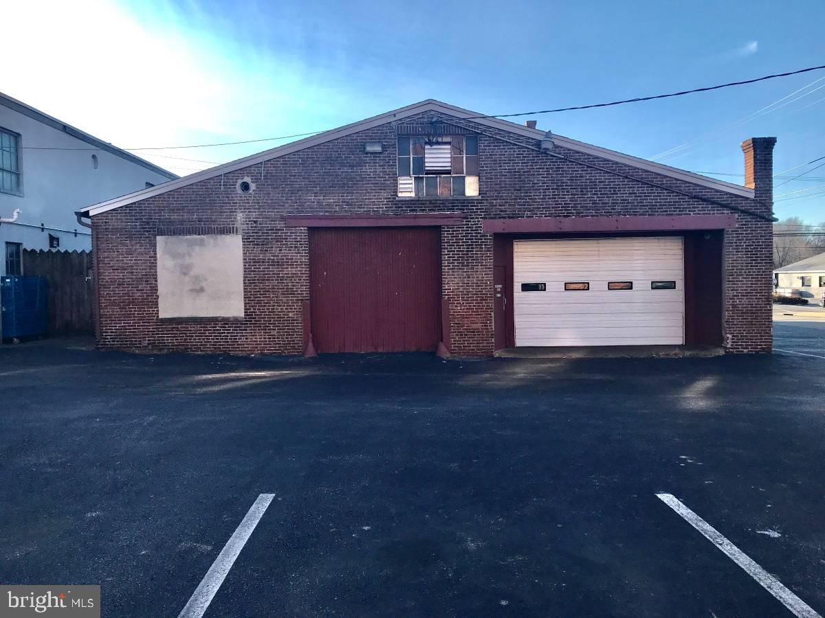 Located in the heart of downtown Phoenixville just steps from Bridge St, this warehouse/garage space is ready for it's next car enthusiast/hobbyist! This garage has a 14x9 door that opens up to a high-clearance, spacious storage area with access to two office spaces and powder room. No commercial usage here, but an amazing space to build, tinker, create, or store!