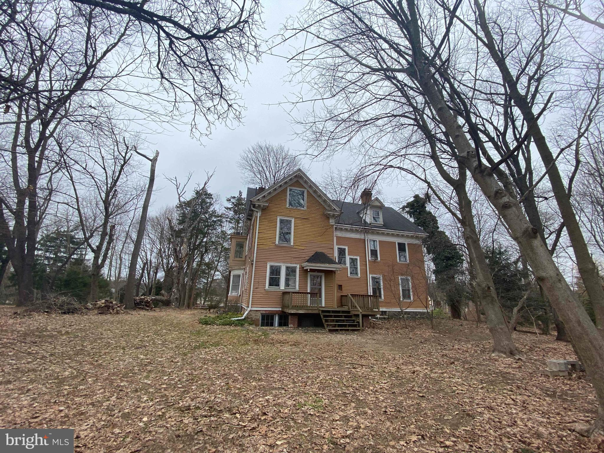 Improve to Own or Flip this large home on 3.07 acres in Prime location.
