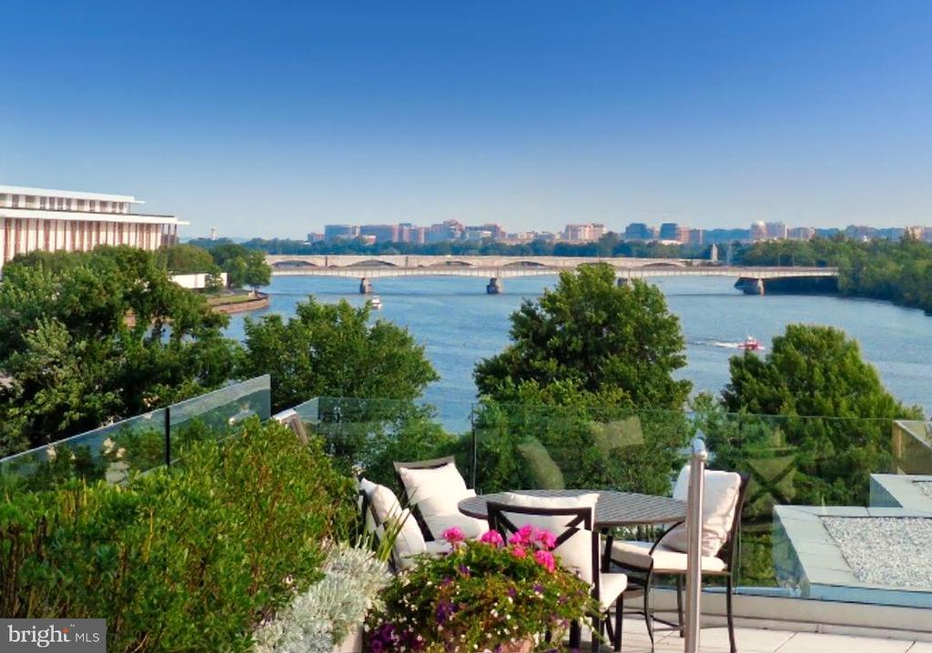 PRIVACY ON THE POTOMAC - DRAMATIC 6,000 SF UNIT WITH A PRIVATE POOL AND 3,400 SF TERRACE.  Situated on the Georgetown Waterfront this magnificent unit offers a unique oasis limited to only six residences.  This luxurious duplex unit includes a private elevator and was  designed for sophisticated and comfortable living. Gracious large entry hall,  living room with fireplace, large dining room , powder room and chef's kitchen and pantry.  Retreat to a lovely library/family room.  Sun filled rooms have easy access to amazing terrace.   The primary bedroom includes a  stunning bathroom and two additional bedrooms and bath  to complete the first level.  The second level  has a study or bedroom, full kitchen, sauna, spa and private gym and full bath #4.  Each floor opens to an inviting terrace with panoramic unparalleled views of the Potomac River, Kennedy Center, Washington Monument and beyond.  2 Garage parking spaces. Concierge in lobby. By appointment - 48 hour notice required.