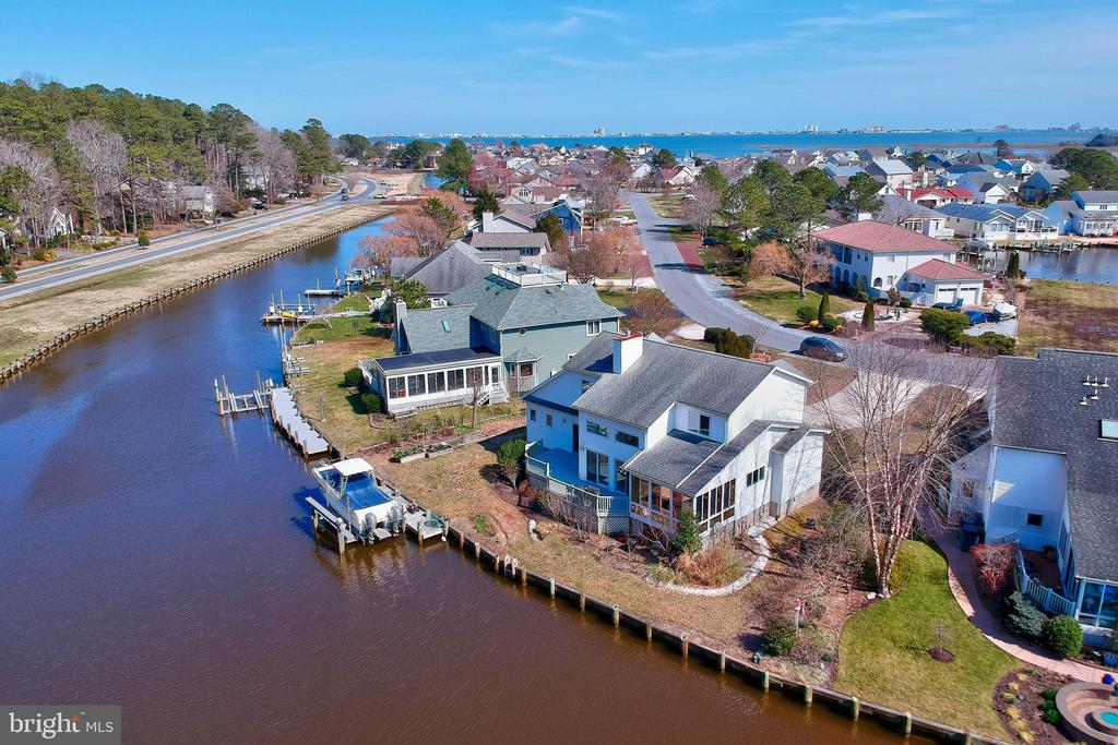 This custom build home is on over ½ Acre of waterfront land located on the desirable Wood Duck Isle and is being sold fully furnished move-in-ready. Spacious waterfront sunroom with a walkout large deck for entertainment. Hardwood flooring and carpet in the open concept living areas feature spacious cathedral ceilings. Both HVAC and hot water heater were replaced within 5 years The kitchen has a downdraft cooktop and double wall oven. The beautiful landscape includes an outdoor shower. 10,000 lb boat lift. With an acceptable offer the sellers willing to give Duel haul Cat 24.6 ft 2001 Boat. Spacious two-car garage. Minutes from Ocean Pines Golf Club, Ocean Pines Yacht Club, 10+ Parks, and outdoors, indoor pool. Schedule your showing!!