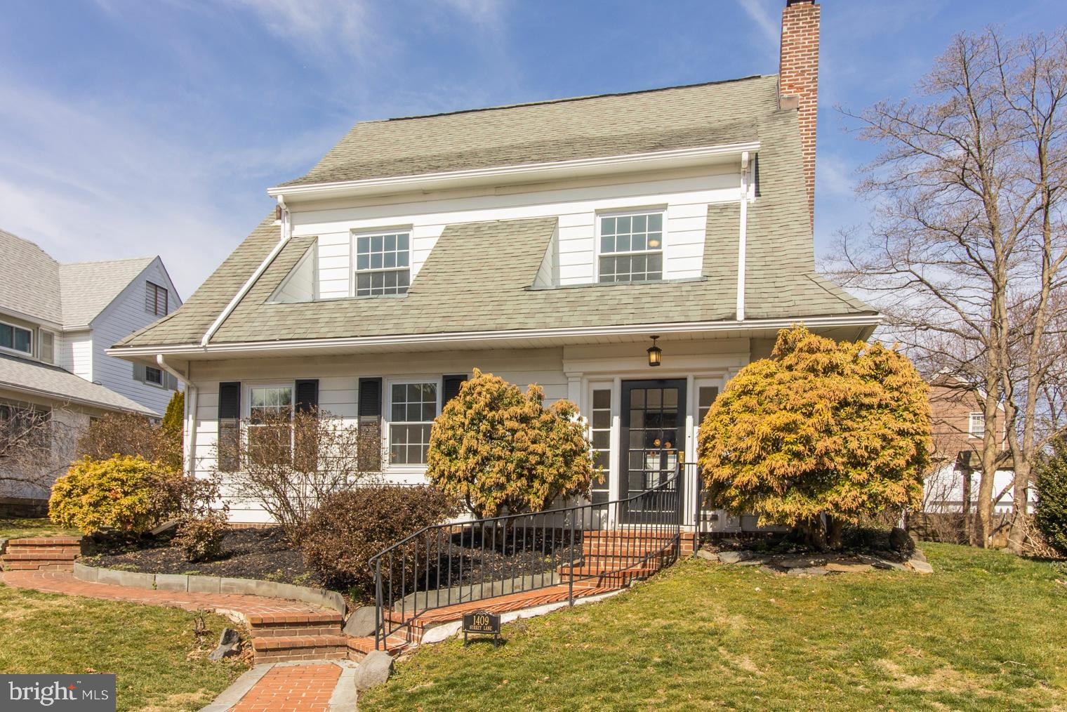 Move right into this stunning Colonial nestled on a quiet street in this family friendly neighborhood in Wynnewood! The curb appeal of this home makes it stand out as one of the cutest homes on the street. A winding brick walkway invites you into a bright and sunny foyer surrounded by windows that will put a smile on your face every time you walk through the front door. Gorgeous tile flooring begins in the foyer and continues into the first floor office that can also be used as a playroom. The open floor plan, abundance of daylight in every room, and the exceptional design marrying the original historic elements with contemporary upgrades are just a couple of the reasons we love this home. It looks like it was taken straight from the pages of an interior design magazine. As you walk into the living room, you feel right at home as its open design gives clear sight lines to the kitchen and dining space while also feeling cozy and warm. Original solid oak hardwood floors, recessed lighting, and paneled windows flow from room to room beginning in the living room where a wood-burning fireplace creates the picture perfect place to cuddle up with a good movie on a chilly night as you watch the snow fall. Through the dining room, a gourmet kitchen will catch your eye and immediately draw you in. All white cabinets, gorgeous countertops, white tile backsplash, stainless steel appliances, and a large island with built-in microwave captivates you and makes a great entertaining space. A half bathroom rounds out the first floor. On the second floor, a large and bright master en suite features a spa-like bathroom with luxury stone/marble flooring and a tile shower with a frameless glass enclosure. You will also find 2 more sunny bedrooms and another high end full bathroom with stone/marble finishes. Another room on this floor can be counted as a bedroom but is currently being used as a closet/dressing room and has a walk up to the 3rd floor suite where you will find another huge 