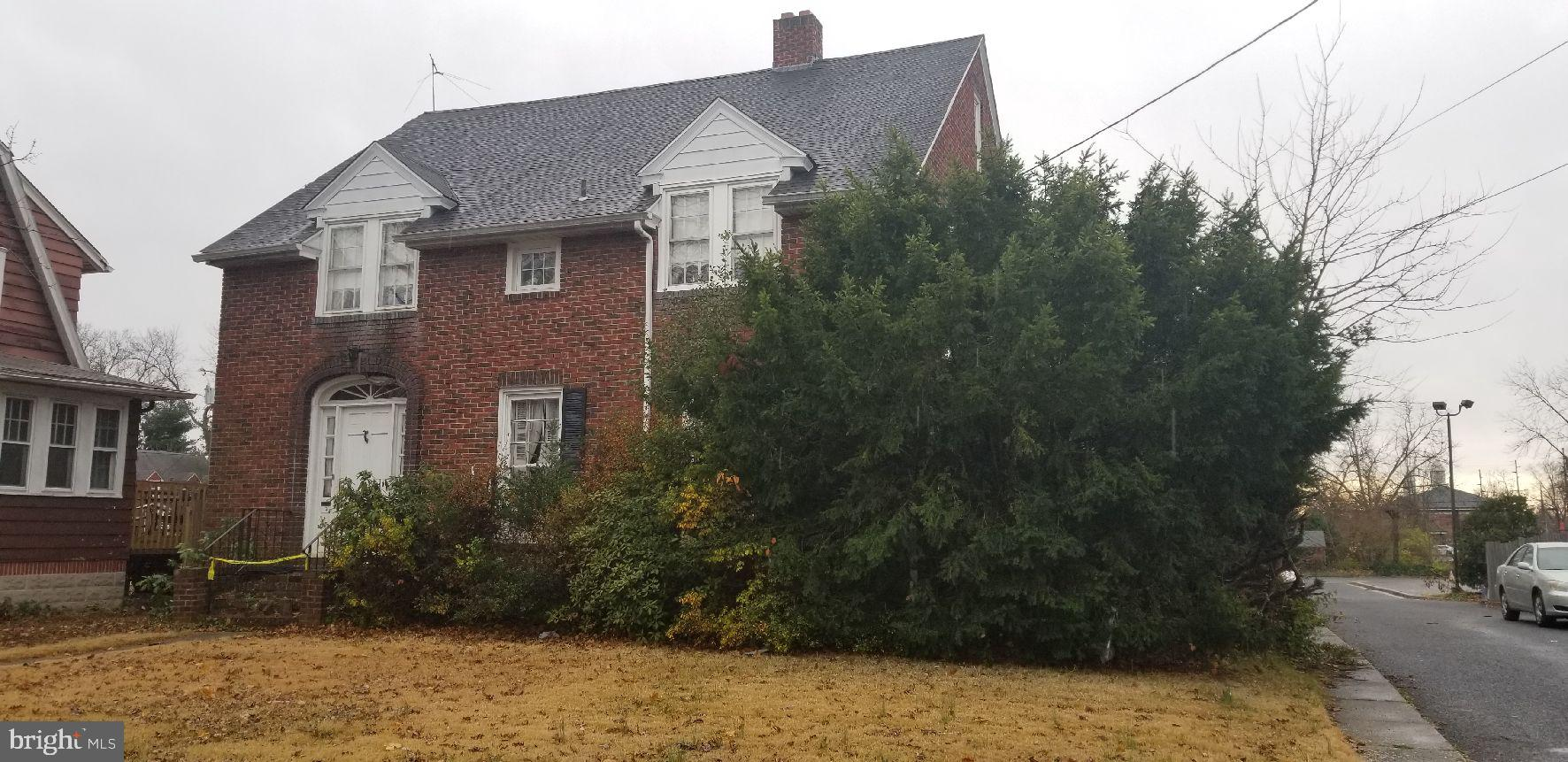 """Great Bones Here - Turn this brick home back into a beauty!!  Being Sold in """"As is"""" condition, looking for a potential gem?  4 Bdrm, 2 1/2 bth, corner location, 2 car garage, Formal dining rm, breakfast rm, walk-up attic, sunroom, Deep basement, hardwood floors, ceramic floors, fireplace , lots of glass doors, Newer windows on sunporch.  Public water and Sewer."""