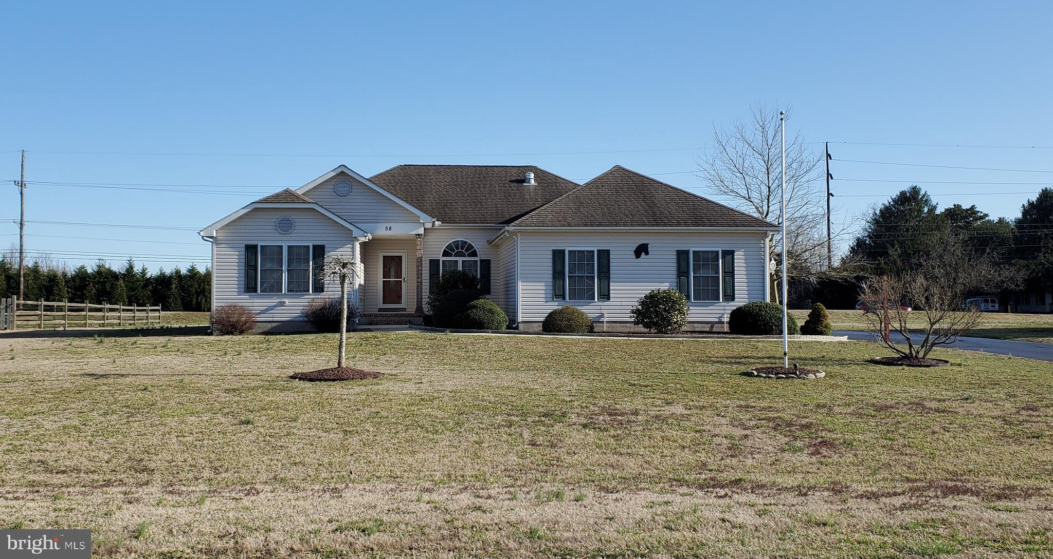 Ready for a new owner, this 3 bedroom 2 bath, open floor plan home is ready.  The main bedroom is fantastic:  21 x 14 with bath that features walk in show, jetted tub, double sink and make up area and water closet,   The walk in closet is large and has organizational shelving.   The kitchen boast bar and island area and lots of cabinets.  This development offers natural gas, community water, and your trash collection is included in your county taxes.  This development is not in city limits so no city taxes here.  The community also offer street lights for your evening walks.  This 2,050 square foot home also boast over sized garage and covered deck.    Septic has been checked out and all is well.  Call today for your tour of this home.  Harrington address but, it is located in Milford School Dist.