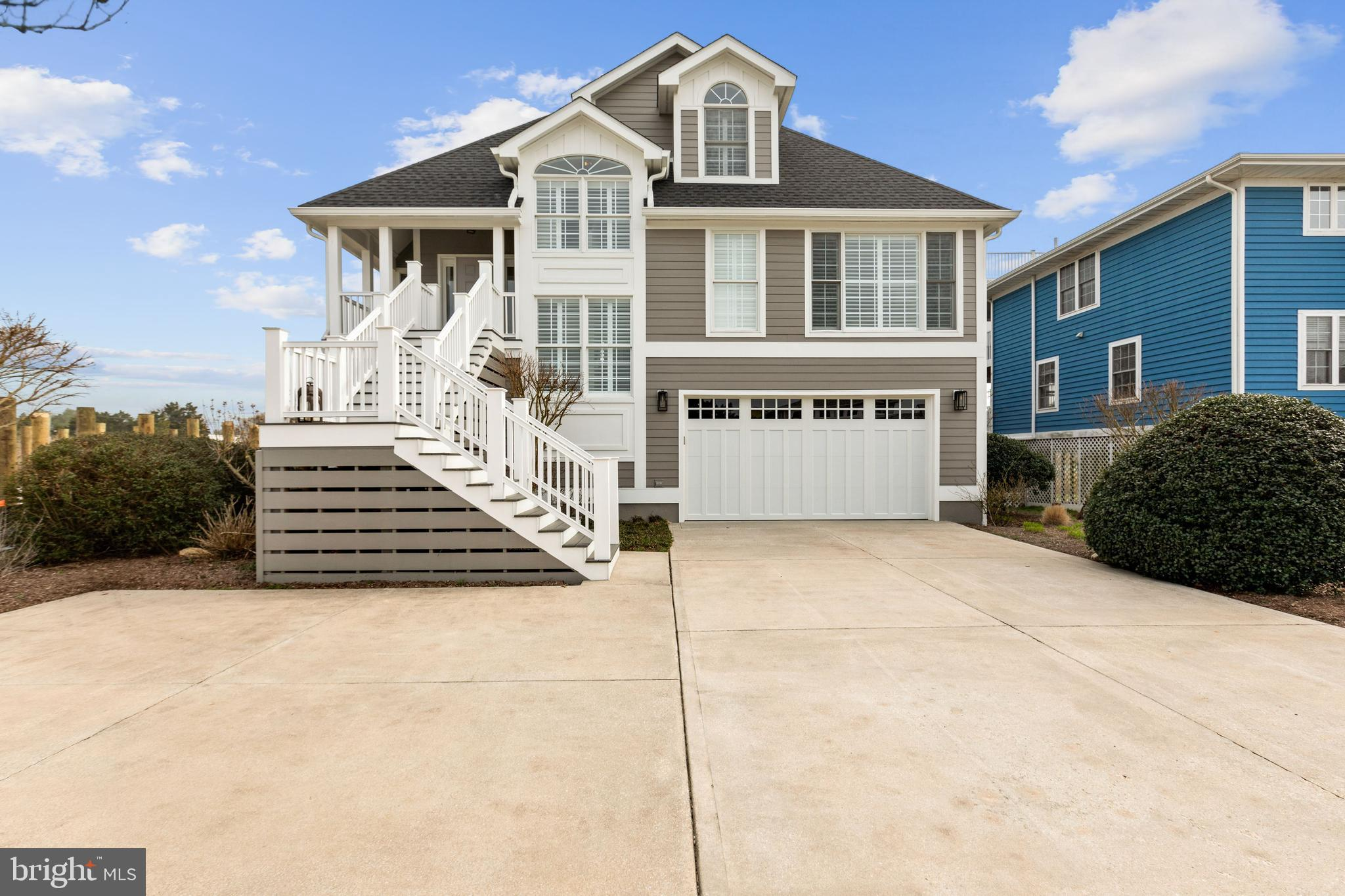 Gorgeous coastal beach home boasting many upgrades in the coveted community of Cape Shores!  Comfortable and sophisticated this home showcases soaring vaulted ceilings, plantation shutters, warm hardwood flooring, expansive palladium windows, high-end stunning lighting fixtures and chandeliers.  Enjoy an open floor plan perfect for entertaining and everyday living.  The cool white color palette throughout is soothing after a hot day in the sun.  A separate dining area and beautiful family room gives access to an elevated enclosed screened porch with serene pond views.  Tap into your inner chef in the gourmet kitchen featuring white Quartz countertops with faint gray veining, a classic subway tile blended with a modern hexagon soft blue/green accent tile, elegant white cabinetry and a generously sized island perfect for those casual meals.  Relax and unwind in the spacious primary bedroom suite complete with a dual sink vanity, a separate tiled shower stall embellished with block glass and a deep soaking tub.  Two additional bedrooms, one with atrium doors leading to an updated composite deck, and a full bath complete the upper level sleeping quarters.    The lower level has a fourth bedroom, a generously sized great room, full bath, laundry and access to the 2-car garage.  This home has been meticulously maintained and updated:   All New Roof/Gutter/Downspouts, Hardi-plank Siding, Exterior Maintenance Free Decking on the Front Stairs/Porch and Upper Level Deck, Garage Door, Porch Ceiling and Screening and a new Outside Shower.  As a resident, you will be just steps to the community pool and close to a private beach, fishing pier and tennis courts.  An easy bike ride or drive to the Cape Henlopen State Park and downtown Lewes boutique shops and fine restaurants.  Don't miss this opportunity to Live At The Beach!