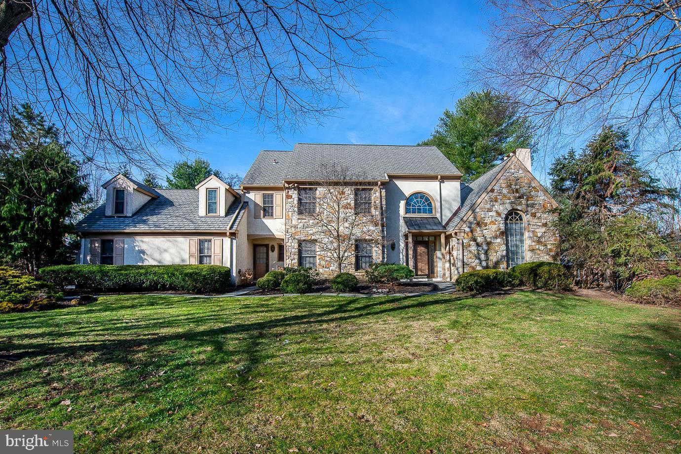 Sitting on a serene 0.69 acre cul-de-sac in Bryn Mawr, you will find this wonderful 5 bedroom, 3 full and 2 half bath, 3740 sq ft Colonial.  Light floods the 2-story, center hall entryway leading you into this meticulously maintained home featuring hardwood floors throughout, a large traditional living room with hardwood floors, fireplace and a large formal dining room with chair rail and crown moldings.  The spacious kitchen does not disappoint with beautiful white cabinetry, center island, granite counters,  and stainless steel appliances including gas range, double oven and wine fridge.  The breakfast room has sky lights and a wall of sliders which lead out to the large back deck which is perfect for those summer barbeques and pool parties.  Conveniently located off the kitchen is the cozy family room with brick fire place and recessed lighting.  Finishing this level are a home office, 2 half bathrooms and a laundry room.  Ascend the open staircase to the primary suite with 2 walk-in closets and grand ensuite bathroom boasting vaulted ceilings, skylights, jacuzzi tub, walk-in shower and double marble vanity.  Four sizeable bedrooms with large closets, two with a shared Jack and Jill full bathroom and a full hall bathroom complete the 2nd floor.  Finished basement offers an oversized play room, second office or gym, cedar closet and storage space.  Don't miss the beautiful level, landscaped backyard with in-ground pool just in time for summer.  Additional features include a full house generator, dual zoned HVAC and an oversized 2-car garage.  Award winning Lower Merion Schools.  Walk to Harriton High School, close to major highways, shops and restaurants.  Schedule your showing today!