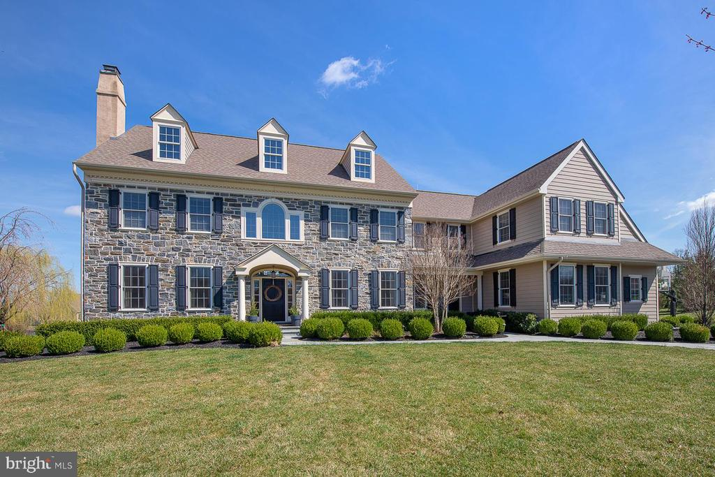 **Video tour  https://youtu.be/azClmaMr0OU ** Located in the sought-after Valley Park community, 139 Waverly Circle is part of a private neighborhood of 31 custom built Bentley homes. The community is conveniently located along Pickering Creek in Phoenixville School District and located close to top rated private schools. This wonderful family friendly neighborhood is one of a kind. Valley Park offers private and spacious lots and sidewalks along the streets for homeowners to enjoy. The center hall entry offers new Marcella European engineered hardwood floors featuring 7 1/2 inch planks that continue throughout the 1st and 2nd floor (2019). Enter left into a large living room with a gas fire place or enter right into the formal dining room. A large private office is set back to the left for a quiet spot to work from home or use it as an extra playroom for the kids. The large open concept family room features a vaulted ceiling, a wood burning fireplace and a back wall of windows adding an abundance of natural light and private views of the backyard and patio. The large open and spacious kitchen offers high end custom cabinetry, a Subzero fridge, 6 burner Wolf range with grill, double ovens, built in microwave and a large island for entertaining. The butler's pantry located between the kitchen and dining room features  Subzero wine fridge and plenty of cabinets for storage. A spacious mudroom is located off the kitchen and can be accessed from the front second porch door or the oversized four car garage and features custom built ins, an additional coat closet and a powder room. Use the back staircase off the kitchen to reach the 2nd floor laundry room with brand new washer and dryer and bonus loft with built-ins and room for kids desks or a large sectional. Perfect for virtual learning or a kids retreat. The 2nd floor features four bedrooms including a generously-sized Master suite, with a sitting area and a massive walk-in custom closet. The basement is estimated at 