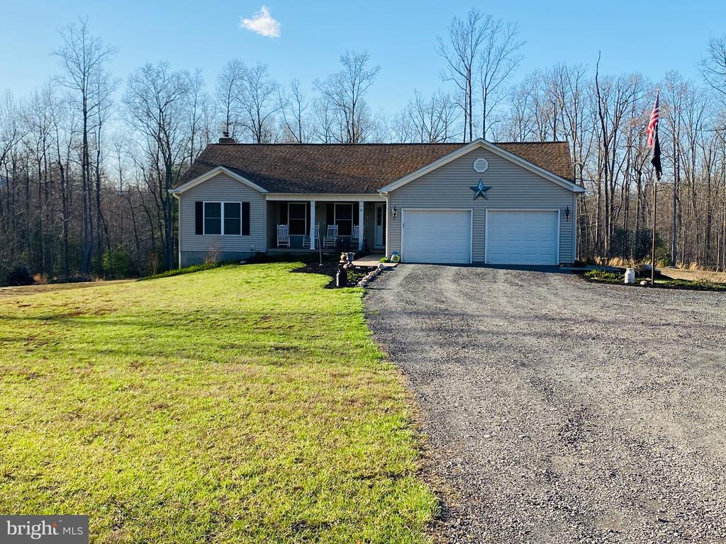 Come see this meticulous home on 30 acres. Enjoy hunting and riding ATVs on on your own little chunk of land. 30' x 40' shop - perfect for a mechanic or any car/truck enthusiast equipped with a wood stove and many other features. Enjoy the pool and beautiful sounds of nature. Outdoor range for target practice also set up on property. Home has open concept kitchen/dining. 3 Bedrooms on main level, open rec room with wood burning stove and another large bedroom, reinforced safe room, huge full bathroom and storage room in the basement. Perfect space for those in-laws or teenagers you may need extra space for. Laundry hook up on both levels. Land can potentially be subdivided by (3) 10 acre lots. Come see this one, you won't regret it!