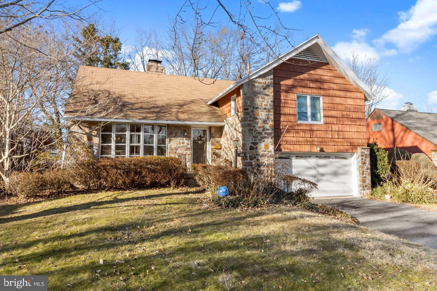 """Welcome to 144 Whitemash Road in the highly desirable Merion Golf Manor, """"One of the Best Places to Live,"""" on the Main Line. This home offers 4 bedrooms, 2.5 bathrooms and over 2,200 square feet. Life in the manor offers a convenient suburban lifestyle with an easy quick commute to the center city or NYC. Lots of great schools public and private, easy access to major highways, shopping, parks and playgrounds. Enter into an open circular main floor bright and spacious with a stone fireplace and large sunny bay window, perfect for entertaining in the living room, dining area and large kitchen. Two steps down from the dining area with double glass slider is the is heated garden sun room with a built in planter full of lush greenery and flowers. Boost your mood & feel like eternal spring during the cold winter, warm and cozy inside. Two steps down from there is an outside patio area full of perennial flowers blooming of the year, a nice yard with a shed for extra storage on the far side of the yard. Just off the patio is the den entrance with a powder room and bar area. Five steps below is a large tiles finished basement with a french drain around the full periphery and a separate laundry area with lots of storage. The upper level has 4 spacious bedrooms. The master bathroom has a ensuite bath with a double head stall shower and 2 closets. The hall bath has a tub. Large linen closet in the hall way. Carpeted now with original hardwood floors through out the main and 2nd floor hall and bedrooms just waiting to be exposed. The top level has a large bedroom/office space or both. 2-car garage with inside access. 144 Whitemarsh Road has so much to offer and will not last! Call to schedule a private showing today! Watch our video tour https://vimeo.com/492291281"""