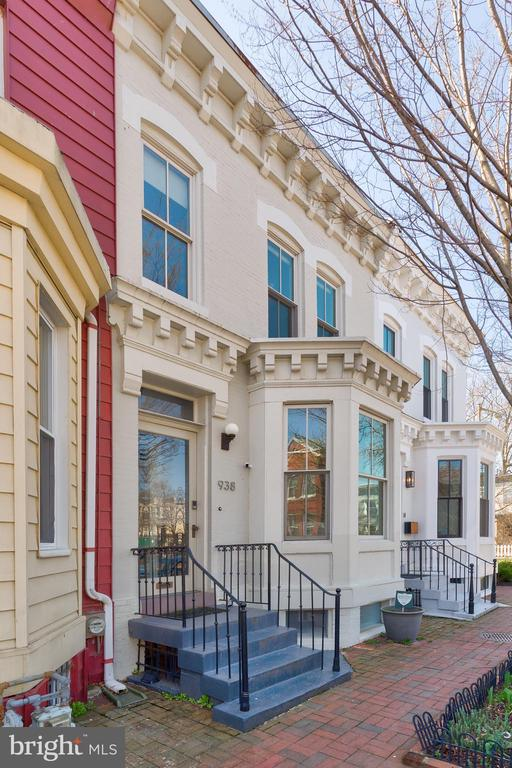 A modern and stylish mix of space, finishes, and location, this Shaw row home on premier French Street boasts open and light filled living spaces. Right across from French Street Park, this location is a dream. The whole home is punctuated with beautiful details including stunning hardwoods, soaring ceilings, and exposed brick. Guests enter via the foyer, and proceed to the living area, perfectly situated with the bay front window. The formal dining room is fit for a dinner party. This flows right to the Chefs kitchen, outfitted with top-of-the-line appliances, expansive countertops, and exposed brick to top it off. Right off the kitchen is a perfect family room ,with walls of windows and a view out to your private outdoor space and secure parking. This level also hosts a full bathroom. The sun-filled and supremely spacious main level is an amazing space to relax, cook, entertain, or lounge. Walking up stairs, you will find two expansive rooms as well as an exceptional flex space featuring built-ins and more exposed brick- think office,playroom, extra family room, and more! The Primary Suite is adorned with gracious closet space and a spa-like ensuite bathroom. The second bedroom is spacious with natural light throughout. The finished lower level is complete with a kitchenette, tons of living space, a full washer/dry, and two large bedrooms and one full bathroom bathroom. As a successful AirBNB in the past, this bonus has endless possibilities-an au pair suite, an in law suite, and more. The vibrancy and convenience of this prized location speaks for itself. Near the METRO, a multitude of green spaces, and some of the city's most sought after shopping, dining, and socializing establishments, this premier Shaw residence is an exceptional place to call home.