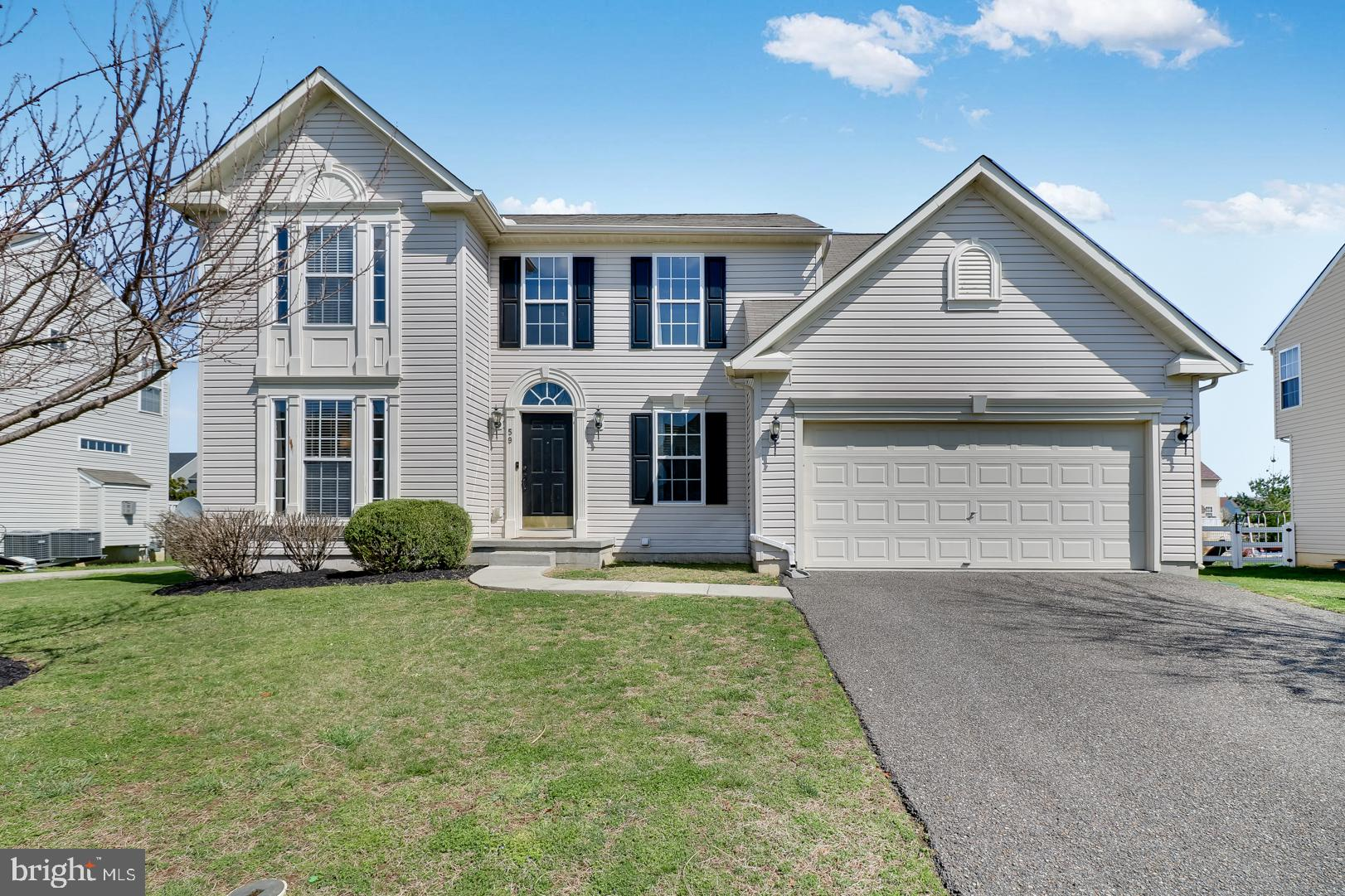 """Welcome to the Beautiful Community of Providence Crossing! Just minutes from shopping and dining, this gorgeous 4 bedroom 2.5 bathroom home sits on just under 1/4 acres with a back yard large enough for a pool, deck, playground or all of the above! General features include energy efficient LED lights, beautifully updated utility room with dimmable under cabinet lighting, and 2"""" blinds throughout the home. Enter the home to a two story foyer open to the upper floor, natural hardwood flooring and a view to every corner of the home.  You'll find a spacious and versatile formal living room that can be used as a home office, and an updated half bath with a beautiful level 3 granite countertop and waterfall style faucet.  The large open concept kitchen is simply amazing, complete with loads of upgrades and beaming with natural light!  Upgrades include, level 3 Alaska White granite, newly replaced stainless appliances, including a quiet low dB dishwasher, gorgeous stone island with power outlets, and pull out storage drawers inside the soft close espresso cabinets featuring stainless T-bar hardware.  You'll also find a large single bowl granite composite sink, Kraus stainless steel pull down faucet, and newly upgraded 3/4 HP Moen disposal.  Enjoy a cup of coffee in the bright sun filled morning room or cozy up by the gas fireplace complete with automatic on/off blower on those cold winter nights.  Downstairs you'll find a huge basement with over 800 finished square feet and another 530+ unfinished square feet ready for your personal touches.  You'll have room enough for creating a 5th bedroom complete with rough-ins for a 3rd full bath, recreation, media, and whatever you can dream up. Pump it up in the newly designed exercise area with an included head to toe wall of mirrors. Even with all that there's still loads of room for storage.   All four bedrooms are upstairs including a monstrous primary bedroom. Primary bedroom won't disappoint with, crown moulding, two large wa"""
