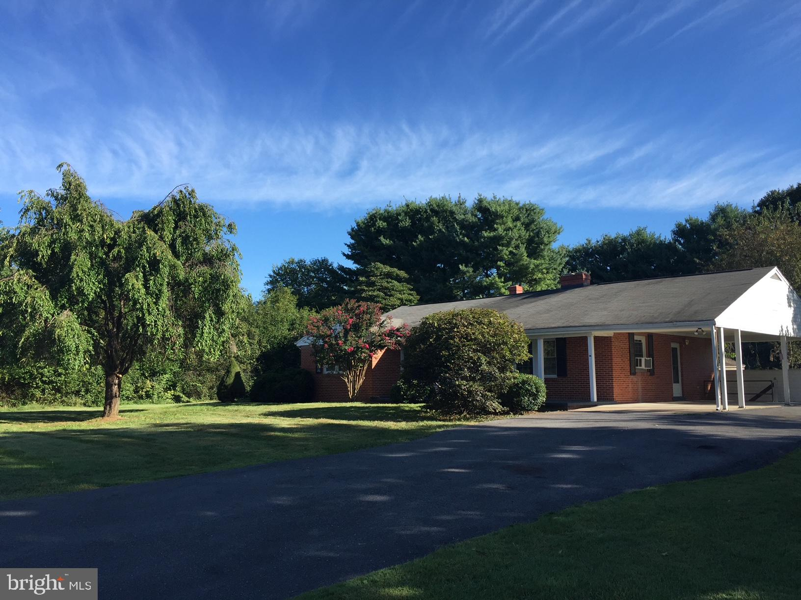 Immaculate 3 BR, 2 BA brick rancher.  Beautiful wood floors throughout the main level, separate DR off eat-in kitchen.  Family room adjacent to DR. 3 bedrooms and 2 full baths, on the main level.   Large finished basement with family room, laundry room, workshop, root cellar, and plenty of storage.  Washer and Dryer downstairs can also be located back up in hallway for main level convenience.  Paved driveway and large carport.  Home boasts a wonderful yard with room for fire pit, garden or what ever your heart desires.  Fireplaces are decorative only.  Note:  Septic system and public water.   Class III rental tax.  Ready for your immediate occupancy.