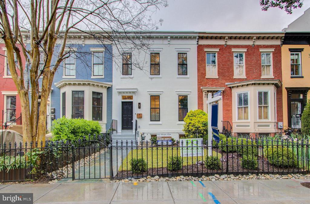 Dilan Investment's newest addition to the 14th Street Corridor, this fully renovated 4 Bed/3.5 Bath row home with off-street parking, set over three floors, marries the character of the home's Victorian roots with modern updates. Herringbone white oak floors from District Floors Depot unify and expansive, open floor plan from the living room with southern exposure and stately fireplace, through the dining area with bespoke millwork and modern chandelier by Circa Lighting. The gourmet kitchen with stainless steel, chef-grade Viking appliance suite, including gas range and wine fridge, and quartz counters, is truly the heart of the home. Flanked by the dining room and a second living or breakfast room, with access to a spacious private deck and off-street parking, this kitchen is an entertainer's dream. Upstairs, the primary suite boasts en-suite bath clad in rich marble tile, with double vanity and glass enclosed shower, as well as a walk-in closet with custom wardrobe organizer. Two additional bedrooms share an adjacent bath with similar finishes and tub shower. The fully finished basement features an additional bedroom and full bathroom, and third living area with kitchenette and plenty of space for dining; an ideal guest suite. The residence is set back from the quiet street, with a deep front yard, making this home a wonderful sanctuary, just steps from the excitement of 14th Street, including Trader Joe's just around the corner!