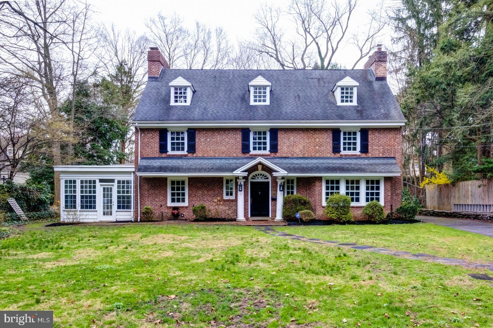 Classic brick colonial with exquisite old house charm in central Ardmore location. Walking distance to both Ardmore and Haverford trains/town centers. Arched doorways, molding, glorious hardwood floors and all the beloved detail you would hope for. Formal dining and living room. Bright sunporch for family room. Updated kitchen with mudroom, wet bar and stainless steel appliances. Upstairs a master bedroom with two closets, decorative fireplace and en-suite bath. Two additional bathrooms (one on the second and one on the third) have been completely renovated. Four additional bedrooms - two on the second floor and two on the third, plus a second floor office. Separate barn above the detached 2 car garage for art studio or other use. Walking distance to Ardmore's Suburban Square, Trader Joes, Lifetime Fitness, Tired Hands Brewing Company and the Ardmore Farmers Market.  Located in the award winning Lower Merion School District. Commuters dream with easy access to train (Amtrak and SEPTA) and all major roadways.
