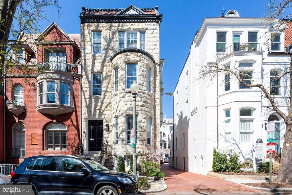 OPEN HOUSES CANCELLED!  Property is under contract!   Welcome to this STUNNING light-filled 1,266 SqFt, 2 Bedroom 2 Bath condo, with PARKING, Washer/Dryer in unit and Low Condo Fee ( $437/ month includes Gas, Electricity, Water, Master Insurance, Trash),  in the heart of the vibrant DuPont, in one of the most beautiful and desirable one-way streets, Hillyer Place, just around the corner from The Phillips Collection, the Dupont Metro, the Sunday Farmer's Market, unique shops, and some of the best restaurants in DC.  Unit 3 is part of a collection of a four-unit Boutique Condo, the Historic Holton House built-in 1866. The building was converted to condos and fully restored to todays' glory in 2017. Unit 3 located one flight of stairs up from the main door, is the largest one in the building, with East and South exposures, taking full advantage of light streaming in.  This large condo offers an elegant and happy space, with original and unique architectural details balanced in perfect harmony with modern touches and finishes. The open floor plan in the living-dining-kitchen area offers versatility in usage and design to accommodate your lifestyle, with its designer chef's kitchen with breakfast bar and top-of-the-line finishes, the beautiful dining area overseeing the tree-lined street, and cozy wood-burning fireplace. The spacious Master Suite has a designer wall of closets, a wood-burning fireplace, a luxurious en suite Waterworks spa-like bath with double vanity, separate shower, and built-ins. The second bedroom, perfect for guest room, has a generous size closed as well as a separate bath with a custom bathtub and vanity. Enjoy the convenience of the in-unit washer/ dryer, located in the hallway, next to additional storage space. The separately deeded parking space ( and additional storage unit), are located off the alley in the rear of the building.