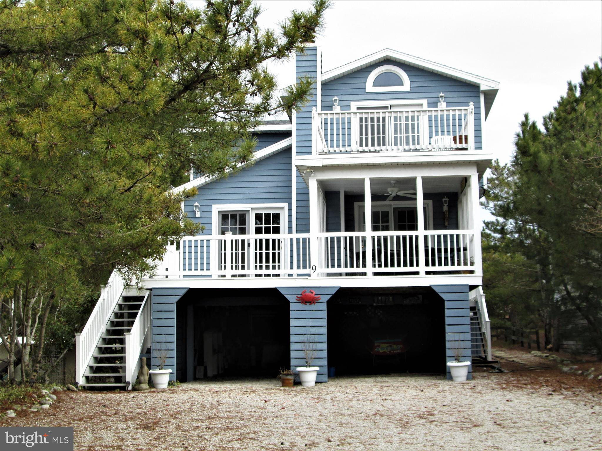 If location is near the top of your list of importance then 9 East Farmington Street will be very difficult to beat.  Not only is it located in the wonderful town of Fenwick Island but it is also a stones throw to the lifeguarded beach within the town limits.  This remodeled home offers cozy beach living with 4 Br. and 2.5 Ba. on an extra large lot.  There is a wonderful sitting at the rear of the house (having its own heat and a/c) which is perfect for a quiet place to read a book or enjoy the conversations after a day at the beach.  The main bedroom is upstairs and has two open decks.  The one over looking Farmington Street does have an ocean view. The smaller rear deck is a quiet spot that will catch that afternoon sun.  Easy to show and see.