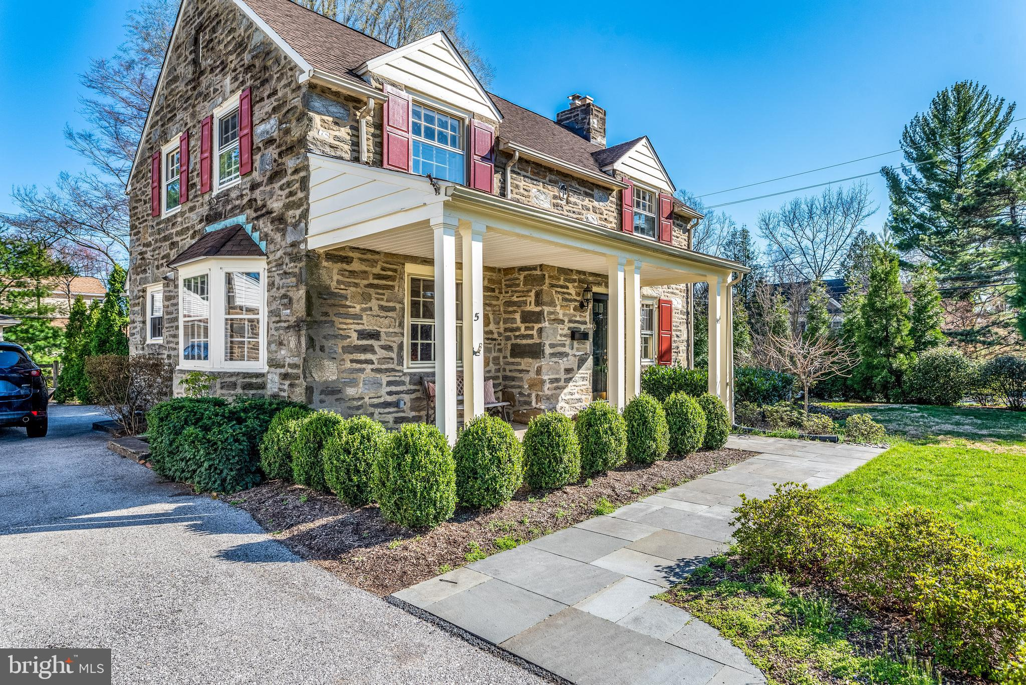 Welcome to 5 Golfview Road, Ardmore in the highly sought-after neighborhood of Merion Golf Manor in Haverford Township!  This classic, and architecturally rich, 2-story 2,062 SF Stone Colonial features 4 bedrooms   2 full and 1 half bathrooms and a detached garage situated on a level, corner lot with mature trees and landscaping.  Greet your neighbors or guests from your inviting front patio as you sip your morning coffee or a cocktail on a mild spring evening. The main floor features a large Living Room with a wood-burning fireplace , hardwood floors, built-in shelving and natural sunlight streaming into the room from the oversized windows with deep windowsills; a Formal Dining Room with built-in corner cupboards, hardwood floors, and a beautiful Bay Window allowing for an abundance of natural light; a newer, updated Kitchen with granite countertops and stainless steel appliances; a main floor powder room; a Family Room adjacent  to the kitchen with hardwood floors and access to the covered, brick patio and rear yard and gardens!  The second floor features the main bedroom with ensuite bathroom; 3 additional bedrooms; a newer updated hall bathroom with a claw foot tub/shower combination! Hardwood floors throughout the entire second floor.  Bedroom 4 has access to a balcony patio overlooking the rear yard and gardens and Bedroom 2 has access to the walk-up attic. The basement is partially finished and provides the laundry area.  Escape from your busy day to the serenity of your covered brick patio and terrace shaded by a mature trees and lush, professional landscaping.  The rear yard is entirely fenced with an additional privacy fence in the back of the property.  This welcoming neighborhood offers a friendly presence and organized functions throughout the seasons.  This home is conveniently located to the Route 100 trolley into Philadelphia, the R5 train in Ardmore; Trader Joe's, Whole Foods, Suburban Square; numerous shops, stores and restaurants in Havertown and 