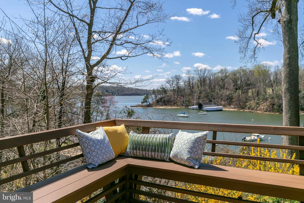 """Enjoy panoramic views of Chase Creek and the Severn River in this classic Pines on the Severn cottage, affectionately known as """"One Love"""".  This unique and charming home is nestled on two lots with creative and colorful landscaping and hardscaping surrounding the cottage.   Over many years, the owner has customized the home with hand built stone walls, vibrant tiles, an iron gate and other character touches that bring to mind-life on the water.  There are wood floors throughout and two fireplaces, a wood burning fireplace in the living room and a gas, stacked stone fireplace in the kitchen.  Windows and doors on the water side maximize the spectacular water views and stunning sunsets.  The generous sized main bedroom has teak flooring along with a sitting area, perfect for relaxing while enjoying the serene water views.  A second bedroom could also be an office or study.  New nitrogen reduction septic system installed in the Fall of 2020. The square footage in the tax record is incorrect.  Water privileged Pines on the Severn is well known and celebrated for its' abundant amenities, which include: sandy beach with covered picnic area, pier with attractive gazebo, boat slips and boat ramp, canoe and kayak storage, playground, ball fields, basketball/tennis cts., community pool and proximity to the B&A trail for walking/jogging/biking enthusiasts.  Easy access to route 50 and major commuter routes and blue ribbon Broadneck Schools."""