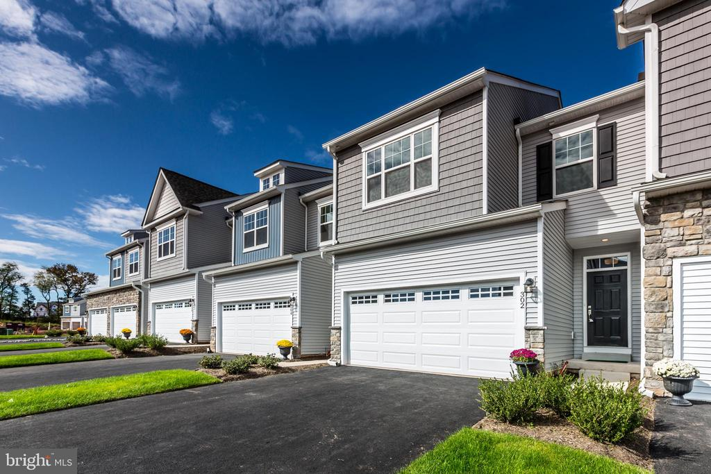 Make your Move Within Six Months into this Brand New Designer Townhome in the Spring-ford School District! This Prestley model includes a finished basement with full bath, 2 car garage, and is loaded with luxurious upgrades throughout. Come see why Enclave at Ridgewood is getting rave reviews as a lifestyle neighborhood for all ages brought to life by ROUSE CHAMBERLIN HOMES, celebrating over 40 years of local quality construction and customer care.  The beautifully appointed interior of this Quick Delivery Home is graced by 9ft. ceilings and captivating wide plank wood floors throughout the entire first level. The popular open design features an elegant kitchen with a generous kitchen island over 8 feet long boasting quartz countertops and cabinetry with soft close construction, stainless steel appliances and recessed lighting. A classic stained oak staircase rises to the second level where the open hall includes a convenient second floor laundry, 3 bedrooms and 2 full baths. Enjoy a deluxe tile shower with seat in the sumptuous owners' suite sporting a raised tray ceiling, walk in closet and recessed lights. With an energy efficient new construction home you can relax with extensive 1, 2, and 10 year builder warranties backed by a responsive local customer service team. Enclave at Ridgewood is nestled in a beautiful natural setting bordering over 88 acres of township open space, future parks and walking paths, yet is just 1.8 miles from Route 422 at Royersford, only minutes from every shopping and dining convenience in Limerick, Trappe, and Collegeville, and even closer to the Spring Valley YMCA for enriching programs, or an invigorating swim any day of the year! The new Signature Series homes are now selling from the on-site furnished model at 300 Ridgewood Drive. The Sales Center is Open Thursday- Monday BY PRIVATE APPOINTMENT from 11:00AM - 5:00PM. The pictures represent the similar Sutton Grand model home. Visit the Rouse Chamberlin website, call, or email toda