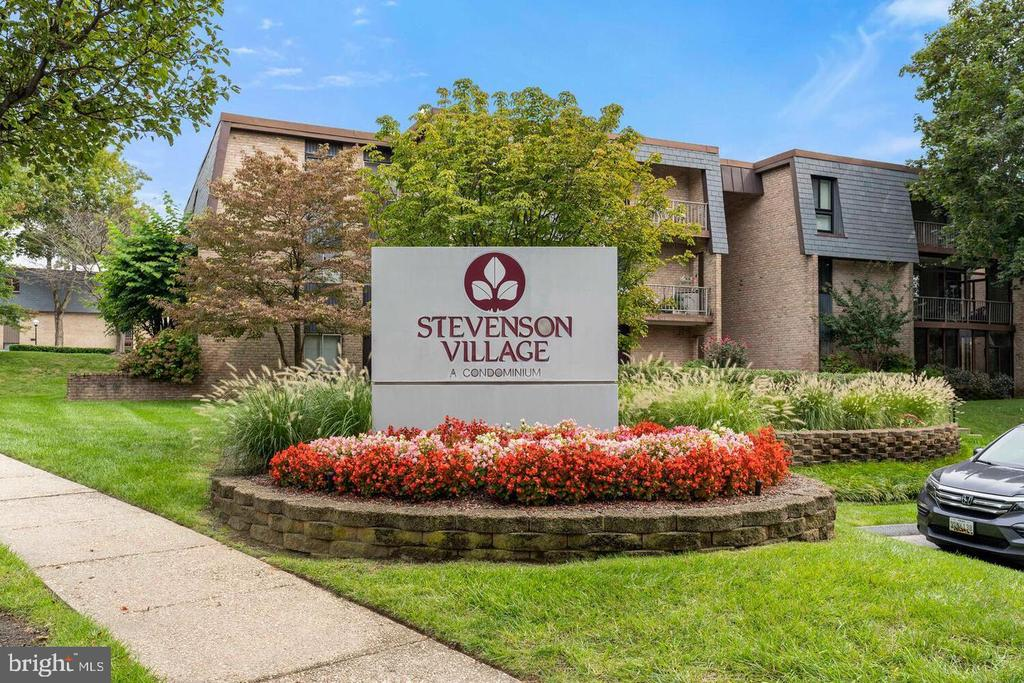 Terrific upper level 2 bedroom, 2 bath + solarium condo in Stevenson Village.  Many updates including Kitchen cabinets and appliances, washer and dryer.  2 Walk-in closets, wood floors throughout, freshly painted, balcony, additional storage, plenty of parking.  Community Pool