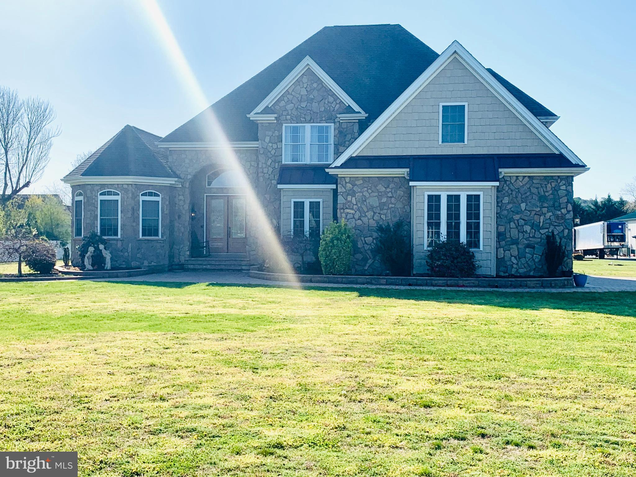 This immaculate home boasts 3000+/- square feet of living space and a two car attached garage on 3+/- acres in a quiet setting.