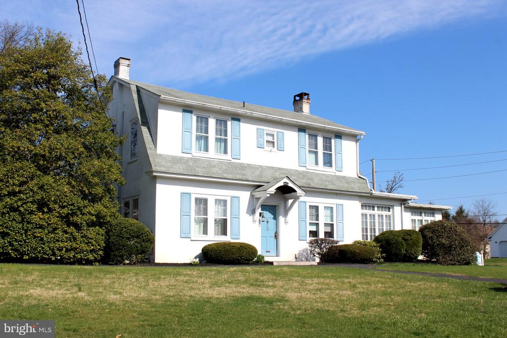 Welcome to this beautifully kept, historic home in the heart of Boyertown. Situated on a spacious corner lot, this home is being sold with an additional parcel, together totaling approximately .35 acres (TAX ID 33-5387-16-92-1611 and 33-5387-16-92-1505). This home features a spacious  living room basked in natural light,  original character,  w/built in cabinetry surrounding  wood burning fireplace. The living room flows naturally into the dining room w/beautiful hardwood floor and kitchen area.  Adjacent to kitchen full bath and first floor laundry w/access to rear yard. Upstairs you will find 4 generously sized bedrooms and additional  full bathroom.  Property was formerly Herb Auto tag service but is single family residence in wonderful neighborhood.  Additionally, there are multiple bonus rooms through out that would be perfect for home offices, additional living areas or storage. The second parcel of office and oversized one car garage. This home has been lovingly taken care of for 40+ years and is ready for new owners who will appreciate its charming potential.