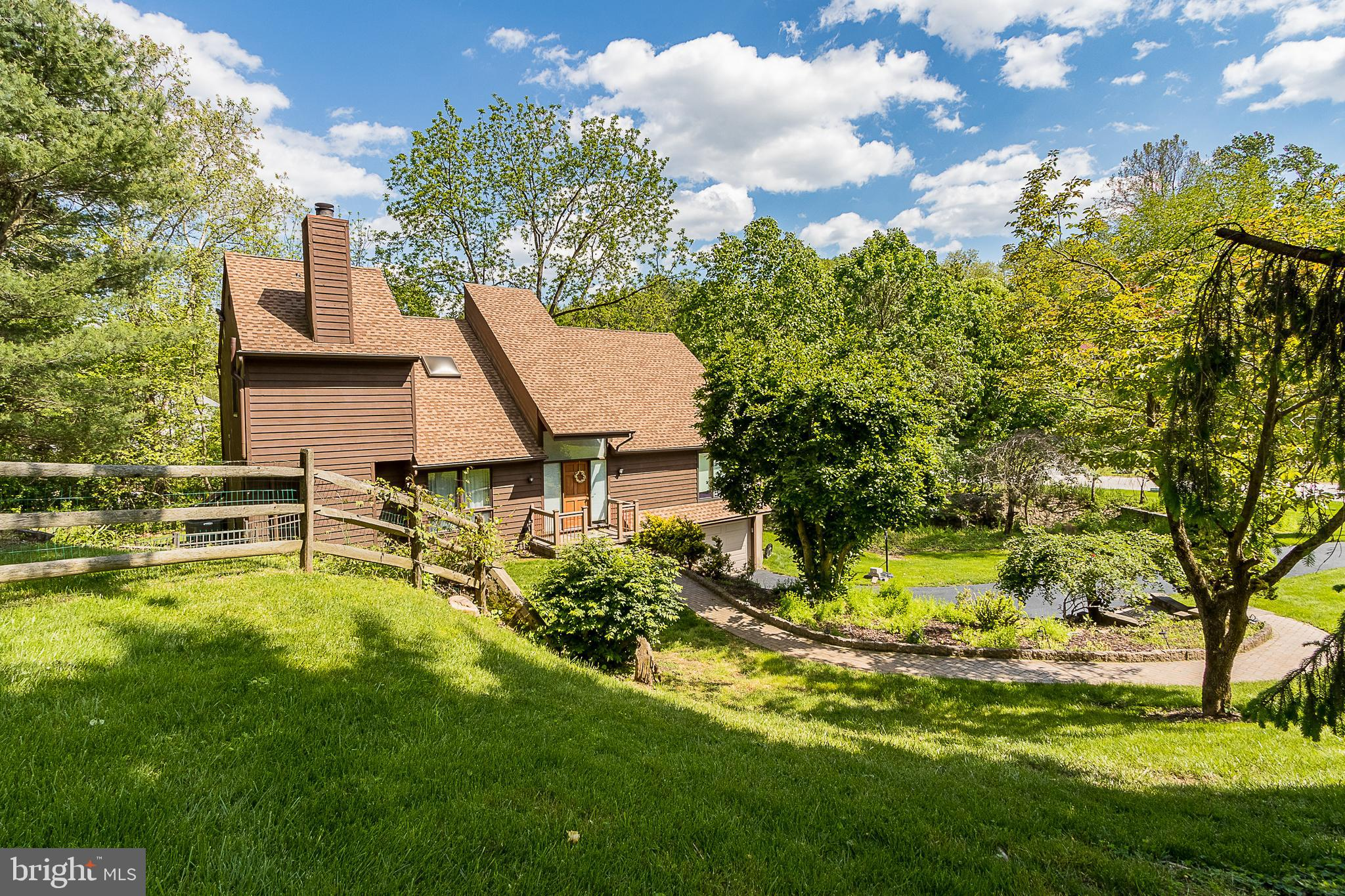 This spectacular home is located in the highly sought-after Radnor School District in Newtown Square. Rolling hills and lush lawns surround this stellar Cedar Siding home.  Open the door to a cathedral style entry with spacious rooms everywhere you turn.   An abundance of wood-framed windows and sliding glass doors allow in plenty of natural light and lead to the oversized 60ft Trex composite deck with breathtaking wooded views.  The comfort continues upstairs with generous sized bedrooms and dreams of relaxation in the soaking tub. Enjoy the benefits of the two car garage and long driveway and the basement which has plenty of storage and potential for a personal gym or additional living space.  Close to major highways, fine restaurants, and golf courses, this home truly has it all!