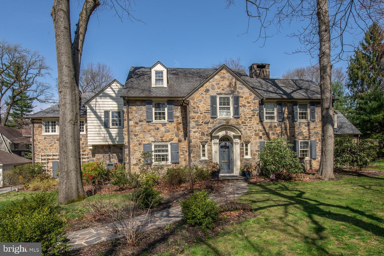 At the end of a cul-de-sac in the desirable Merion Station neighborhood sits a lovely stone Center Hall Colonial. Follow the newer flagstone path to the elegant front door. Upon entering the grand entry with a beautifully curved staircase and 9 ft ceilings, you'll find formal dining to the left and a grand living room with a wood-burning fireplace to the right. Through the living room are French doors to the covered porch. Butler's pantry with Soapstone counter, copper sink, Ann Sacks backsplash, and V-Line beverage fridge. Another exit to the flagstone patio, great for entertaining. Amazing cooks kitchen addition by Architect Abby Schwartz has every high-end appliance you could think of, not limited to built-in Miele coffee maker, Miele convection/micro oven, Wolf range, Gaggenau steamer with water filler spigot, Dacor warming draw, Julien stainless sink, Bluestar refrigerator, Bosch dishwasher, and two Fisher Paykel dishwasher drawers. Accenting the kitchen are the Portobello cabinets, a large center island with hidden utility drawers, banquet seating, and a dry stack stone gas fireplace. The ceiling in the kitchen is vaulted with shiplap and extra second-story windows allowing light to flood into the space. Another set of doors with hidden screens exits to the flagstone patio dining area. Family room off kitchen leads to double size mudroom and garage entrance. Custom Waterworks powder room. Back stairs are very conveniently located off Mudroom area. Sun drenched office with newer windows and built-ins. The whole home has beautifully finished hardwood floors. Owners suite with crown moldings, walk-in closet, Juliet Balcony, and bath featuring Kohler whirlpool tub, shower, and built-in make-up station. Fabulous laundry room with sink, built-in cabinets, and ironing board hidden inside drawer. Bedroom 2 has wood floors. Bedroom 3 has wall-to-wall Ralph Lauren carpeting. Bedroom 4 opens to the hallway powder room. 3rd floor has 2 more bedrooms, and 2 full baths, one