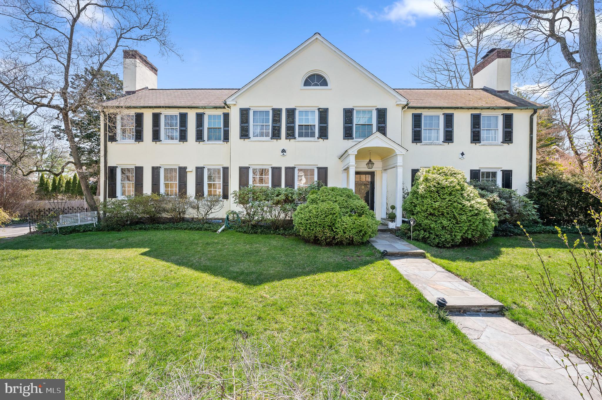 This Walk-to-Bryn Mawr 4+ Bedrooms and 3 full / 2 half bath circa 1920 Colonial is situated in a park-like setting on a Private Road with walkability you'll love:  1 block to R5 Septa Rail and Ashbridge Park and short walk to Tredici, La Colombe, Blue Mercury, Post Office, CVS and other downtown Bryn Mawr shops.  111 Ringwood is both stately and majestic as its set above a stone wall lined with red roses in the summer.  The stone wall proceeds up the driveway to the garage and side entrance and the stone staircase from the road leads you up to the Front Door Portico both hinting that you are in for something special.  When you step into the large Foyer, you immediately notice high ceilings and hardwood flooring throughout, hall closet and woodwork so desired in a Main Line home.  Off the Foyer is a grand sun-lit Living Room with built-in book cases, decorative fireplace, large windows, and two sets of floor-to-ceiling French Doors that open onto the stone terrace creating the perfect place for family gatherings.  The Formal Dining Room has french glass doors that lend privacy for entertaining thru late hours.  Morning coffee or your favorite show can be enjoyed in the Family / Sun Room that offers views and access to the backyard and stone patio and hosts the main floor powder room. The updated Eat-in-Kitchen is dreamy with white custom cabinetry, granite countertops, Subzero Refrigerator, large DCS range with Double Oven, Wolf Convection/Microwave Oven, KitchenAid Dishwasher, main sink over looking the front yard, and prep-sink near range.  The Kitchen also offers walk-in Pantry, bar stool seating for 4 and table seating for 6 people.  Bringing in groceries is easy thru side entrance.  Ascend the turned staircase to Second Floor where you'll find a large Primary Bedroom En-Suite with two closets, decorative fireplace and a remodeled Full Bath with glass shower doors, heated towel rack and fog-less vanity mirror.  The Second and Third Bedrooms have dual access to th