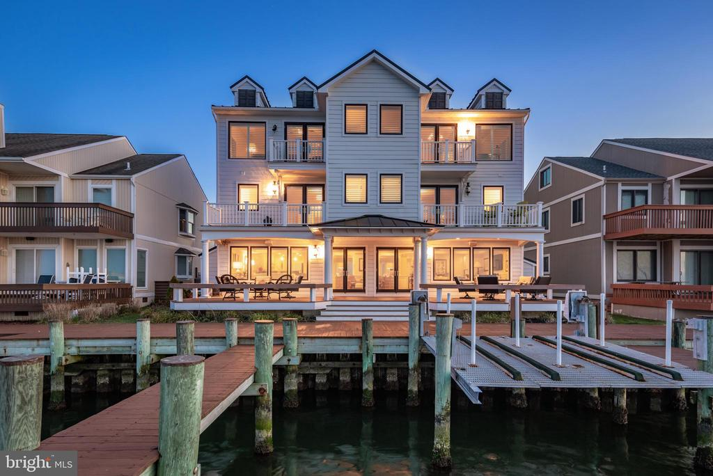 Runaway Bay: quite possibly the best kept secret in Ocean City!  This estate-style home is situated on the bay-front of Ocean City's Assawoman Bay.  Completely remodeled by Beachwood Homes, the resort area's premier contractor, this luxurious residence features the finest quality construction, lavish designer decor, an acute attention to detail, and unparalleled bay views.  Boasting seven spacious bedrooms, including an oversized top-floor owner's suite with vaulted ceilings and its own private sitting room.  All sleeping quarters are complimented by six lavishly designed full bathrooms and two half-baths.  The residence is wrapped in windows, allowing plenty of light throughout the home and always gracing you with stunning views, from watching the herons sweep across the bay in the morning to the deep reds, oranges & purples of the sunsets.  The home's design also features five bay-front decks, a gourmet kitchen complimented by Italian Marble counters & a custom tiled backsplash, along with top-of-the-line appliances.  Owners and guests will enjoy the many upgrades throughout, including extensive mill-work, coffered ceilings, 4 zone HVAC system, hardwood floors, a custom dual-sided staircase, wet bar, and expansive waterfront decks.  If you're looking for room for boats (and lots of them), you're covered with enough space to park multiple boats and up to six wave-runners!  Make this your new beach retreat, schedule a private showing today.  Lot square footage is an estimate.