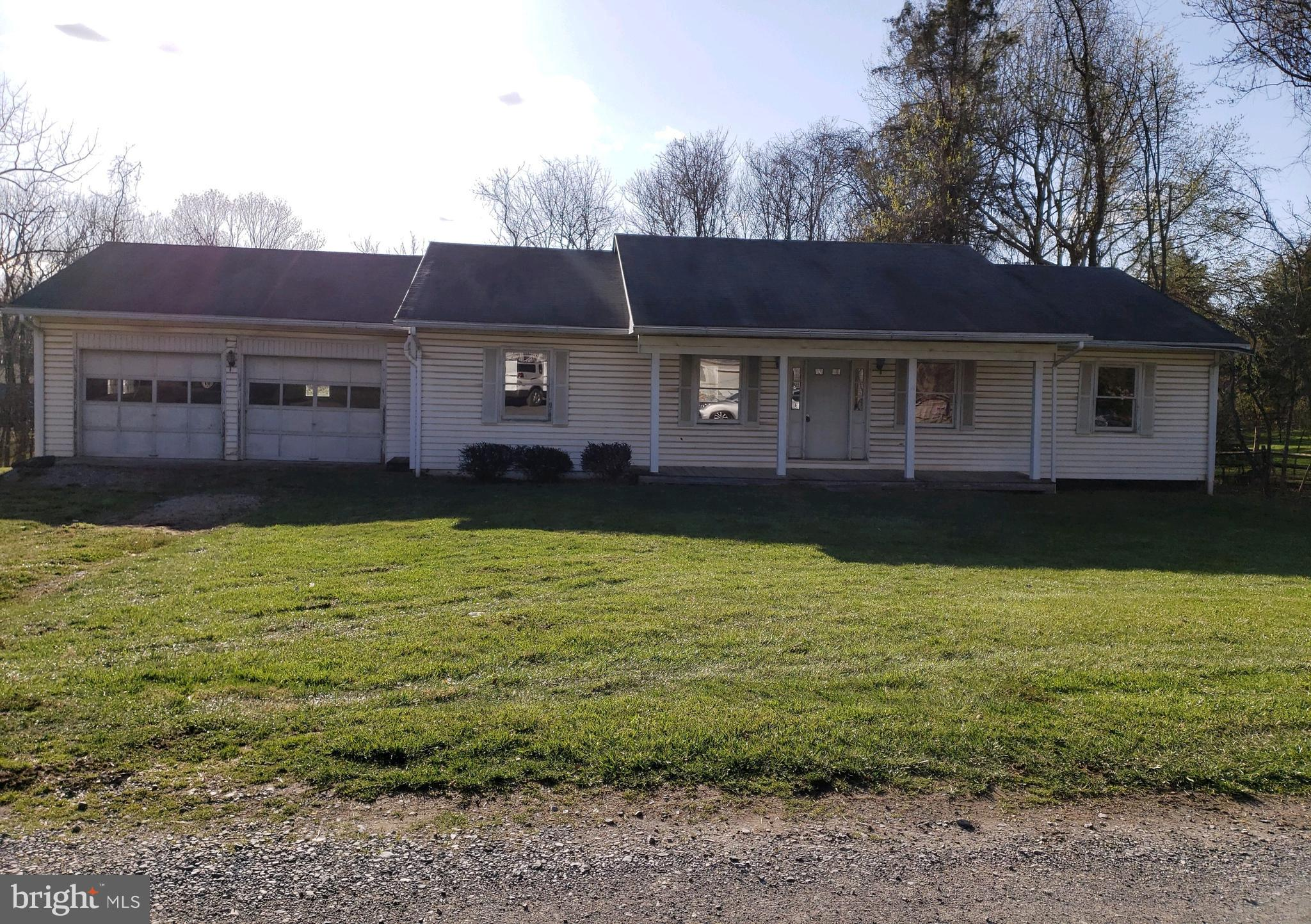 Rancher located in Blue Ridge Acres on a corner lot, 2 bedrooms, 2 bathrooms, full unfinished basement, attached 2 car garage and a covered front porch.  Offers due Monday 4/12/21 by  9am