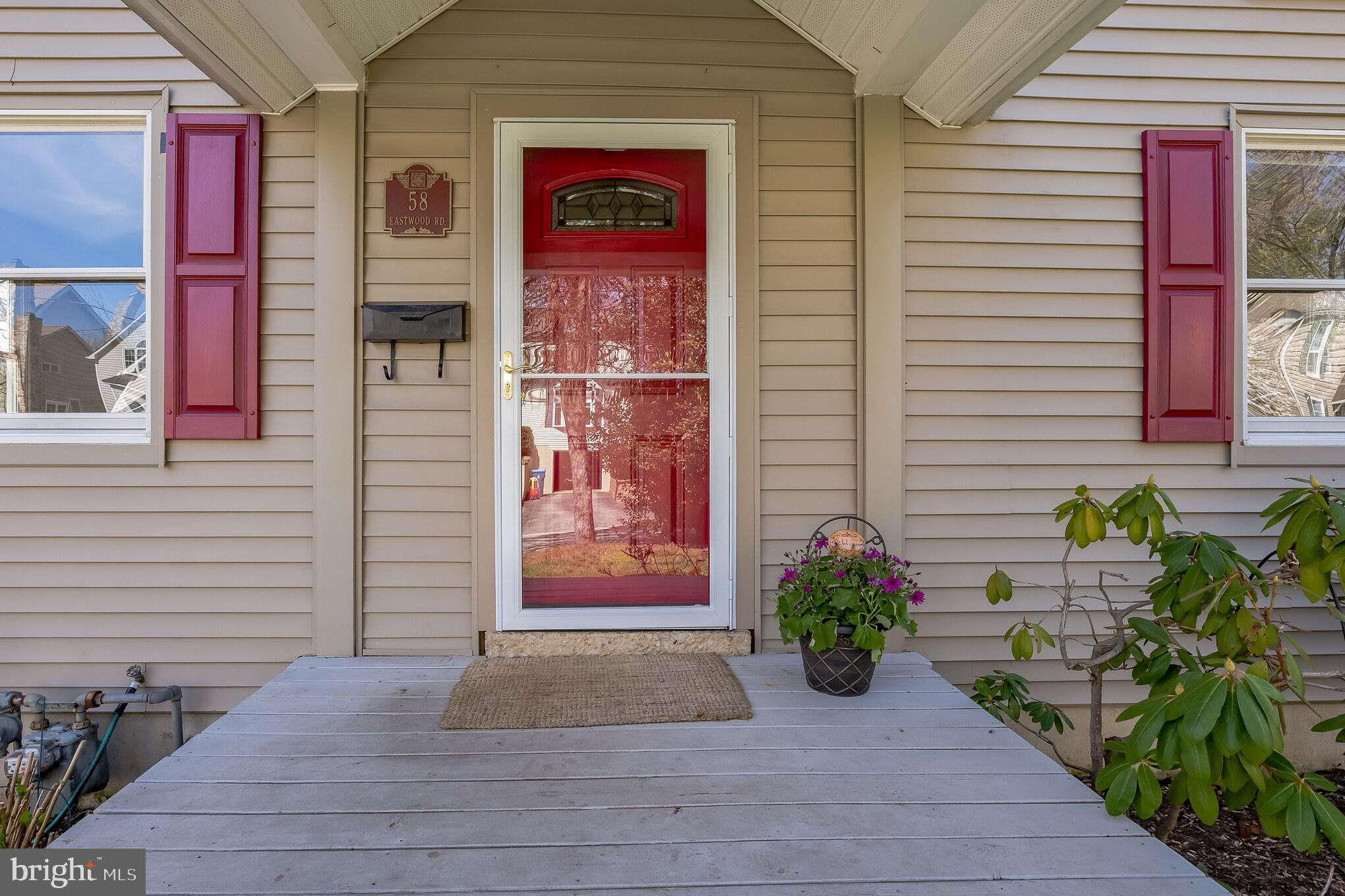 """Welcome to 58 Eastwood Rd. Berwyn, Charming, Darling, Comfy describes this perfect salt-box Cape Cod in the heart of Berwyn. Maintenance free exterior with front porch greets the buyer as you enter the first floor. First Floor: newly refinished beautiful hardwood flooring living room with coat closet, bright cheery windows allows lots of light to stream through, Dining Room with double sliding doors leads to tiered deck overlooking private back yard. Kitchen with white cabinetry – dishwasher, refrigerator, ceramic tile backsplash. 2 Large Bedrooms with crown molding- built-in cabinetry, ample closets. Full ceramic tile bath with tub/shower combination, white vanity, linen closet. Second Floor: Large updated ceramic tile bath with beautiful vanity with wood cabinetry- ceramic tile flooring, ceramic tile stall shower, 2 additional spacious bedrooms with walk-in closets, ceiling fan, chair rail, hardwood flooring. Lower Level: Partially finished with built in shelving, storage closet can be used as office, playroom, work out area. Laundry area – storage area, separate storage closet with shelving, and workshop area. Outside entrance to idyllic back yard. Custom 2 maintenance free deck perfect for summer entertaining. Additional storage shed. Back yard is a one of a kind with a bridge over small stream and separate area for gardening already in place. Amenities: New Roof Owens Corning Architectural Design Shingles (2021); Newly Sanded/Stained Hardwood Floors (2021); Resurfaced Asphalt Driveway (April 2021) Freshly Painted Interior (March 2021). Location is ideal: walking distance to ever popular """"Handel's Ice Cream"""" shopping, library, restaurants, SEPTA  rail into Philadelphia, major access routes, King of Prussia Towne Center, King of Prussia Mall- Award Winning Schools- Location-Location-Location- A Must See Home!"""