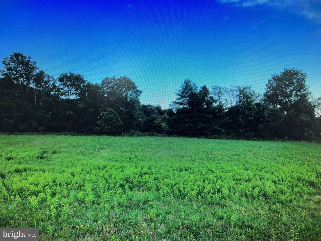 Lot 3 on Levengood Rd. in Douglassville, Pa. A 1.86 acre lot in the country with great views of surrounding countryside. Keystone Homes Nottingham Manor Model could be built on this lot which is a 4 bedroom 2 1/2 bath 3,616 sq. ft. home with a first floor owners suite for $489,543.00. Lot 3 requires a micro-trench system. for septic. You may go to https;//www.keystonecustomhome.com/find-your-home/media-gallery/photos/Nottingham/?