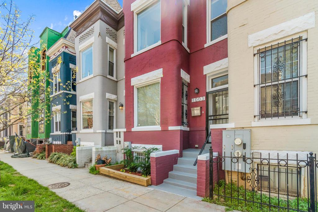 """Enjoy a Spacious New Home and a Fabulous, Urban Lifestyle Life doesn't get more """"D.C."""" than it does when you're living in an incredible, 2,238 sq. ft. Capitol Hill-style townhome situated between two of the Districts most exciting neighborhoods. Built in 1905 and renovated just this year, this 4 br, 3.5 bth townhome is a short walk from all of the fabulous culture, cuisine, shops and bars of NoMA and the H Street Corridor, including the famous Union Market. If this is too much space, neighbors had $20k bnb income in 2020. Step inside your townhome and enjoy wonderfully comfortable living with spacious rooms, plenty of natural light and dual-zoned HVAC. The back of the house provides great getaway space with a privacy-fenced courtyard and decks on both the first and second floors that look out on your lovely residential neighborhood. The top-to-bottom renovation features all new flooring throughout, gorgeous bathrooms, an incredible kitchen with a gas stove and a separate dining area. The finished basement isn't your typical TV room, either; it's a big, brand-new living space that could easily be an income source as a rental for students at nearby Gallaudet University. Being in one of the most walkable areas you'll find anywhere, you don't have to have a car at this address, but if you do there is on-street parking for residents. Wherever you need to go in the D.C. Metro, you can get there easily by being so close to NoMA-Gallaudet Metro Station. The urban D.C. lifestyle your looking for is waiting for you at 1003 Florida Ave NE."""