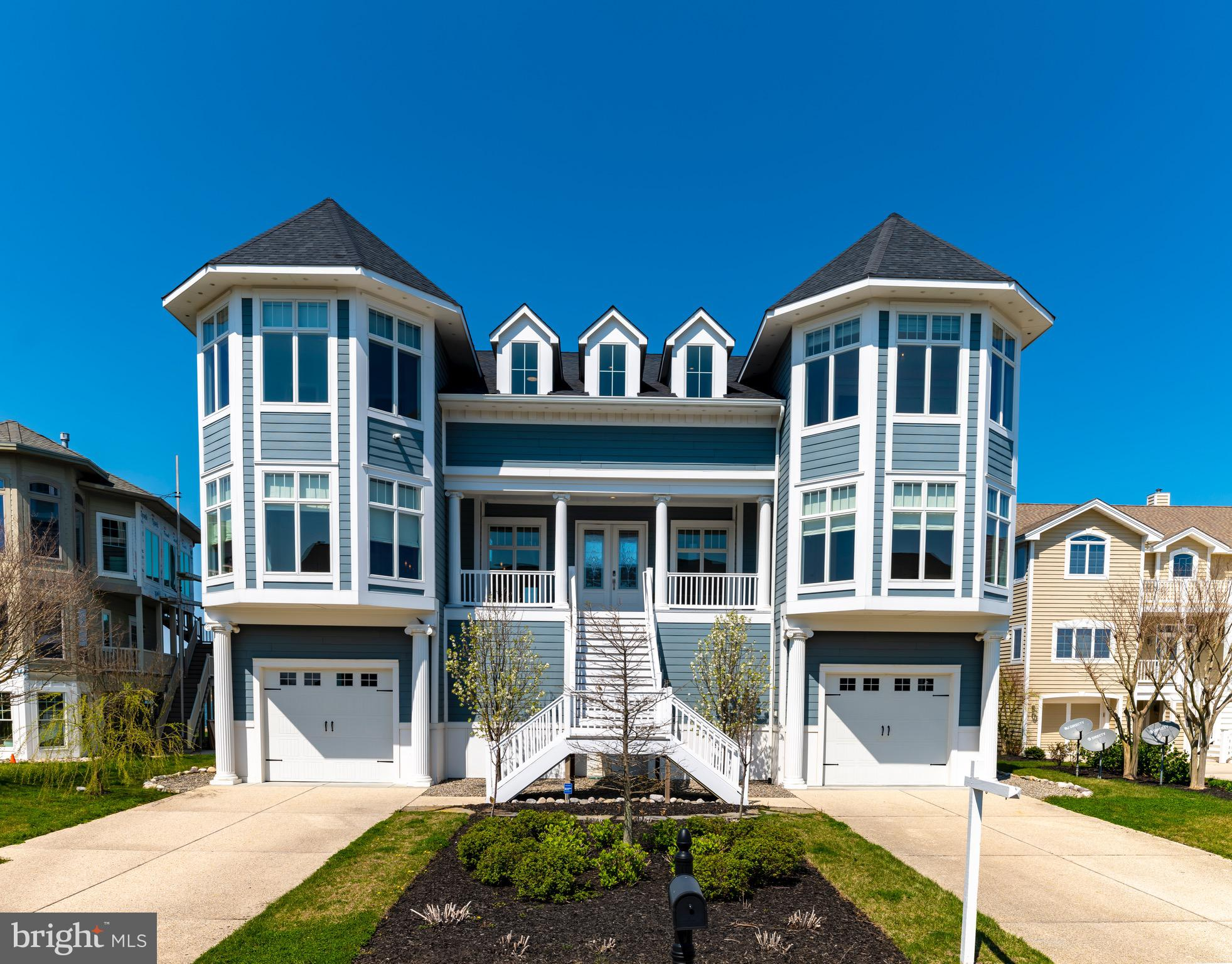This unique home truly defines coastal lifestyle!  Located on the South Side of the Indian River Inlet. Within the protected boundaries of the State Park,  this home is only 5 miles from both Bethany and Rehoboth Beach.  The community of South Shore Marina is gated with amenities such as, a swimming pool, tennis courts, a clubhouse and a marina. The beach is accessible by bicycle, golf cart, on foot or by car (beach parking is provided by State Park.) Other activities include oceanfront dining and various State Park amenities along with a restaurant right down the street! After you've enjoyed a fun-filled day, it's time to go and enjoy your 12,000 sqft WATERFRONT home - newly built in 2016. There is a water view from every window! This home features 7 bedrooms, 6 full baths and 2 half baths.  Notable features include partial steel framing, Wolfe appliances, double laundry rooms (lower and upper floor) and an elevator. To say the least, this home is designed to entertain both families and guests and guaranteed to be the most spacious within this price point.  The open floor plan and cathedral ceilings create an extremely high end setting.  The owners built this home to personal standards that convey quality and craftsmanship at every corner.  You're invited to come see this home for yourself!