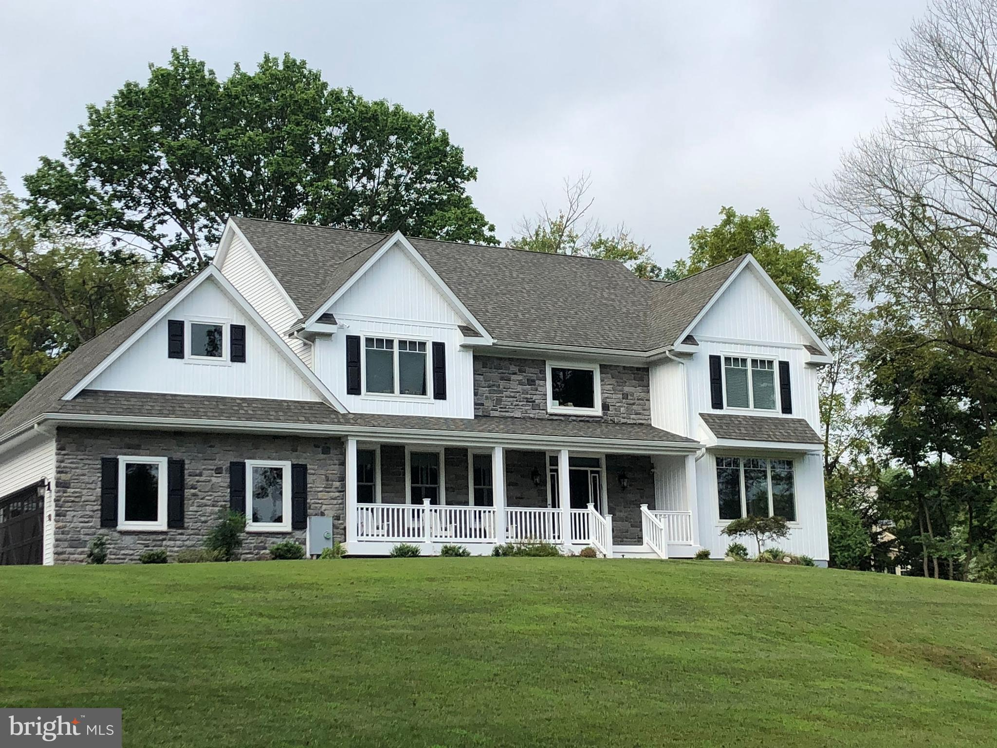 TO BE BUILT -NEW Custom home with  4/5 bedrooms in coveted TE Twp. set back from the road on just over 1.25 acres!